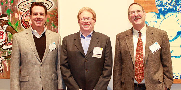 Pictured L to R: Professor William Ryan, Outstanding Alumnus Stewart Lander and Interim Department Head Bill Ross at the reception.