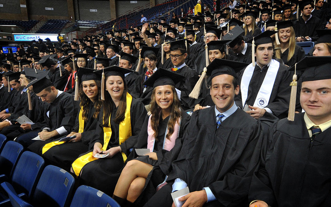 The Class of 2015 is all smiles as the students wait to receive their degrees.