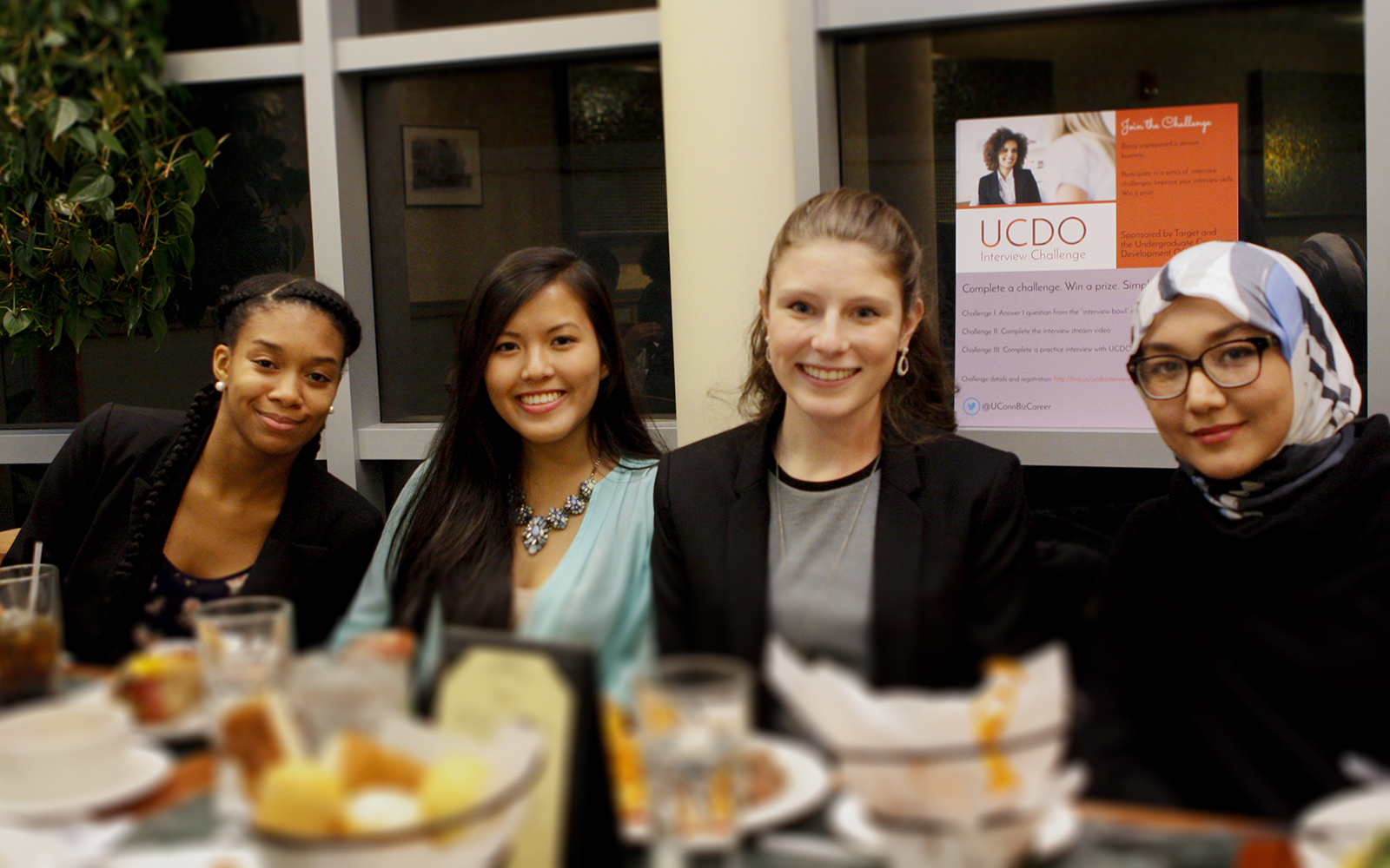 Interview Challenge participants enjoy dinner at Chuck & Augie's restaurant on December 8, 2015 (Juanita Austin/UConn School of Business)