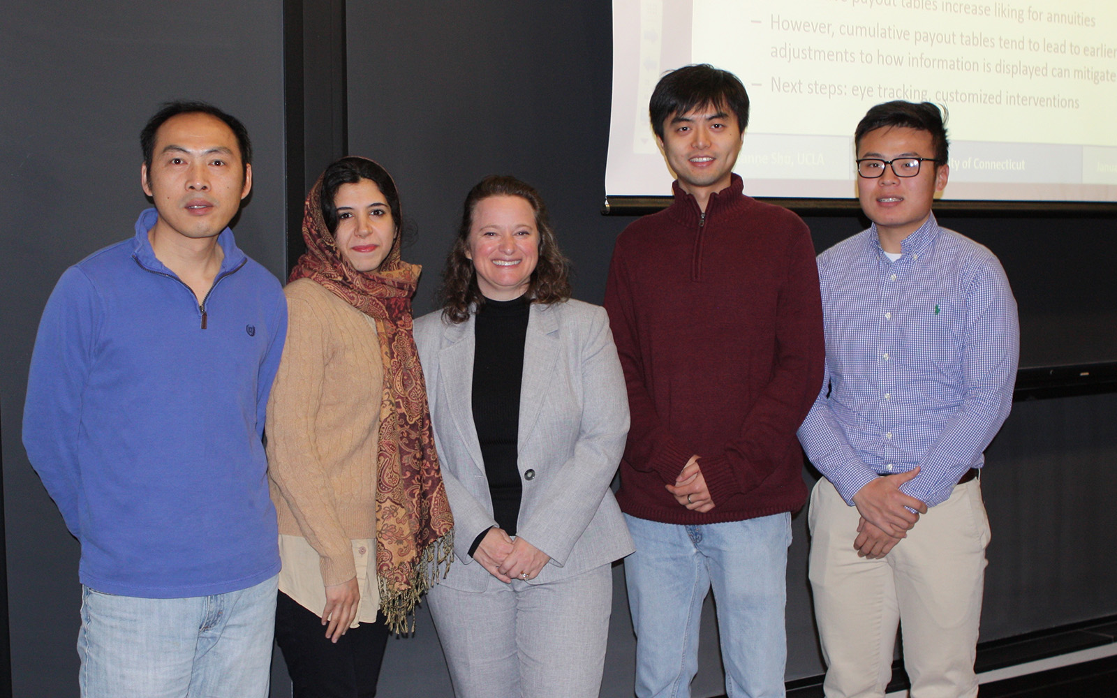 Suzanne Shu (centered) with Ph.D. Students Bin Li, Zahra Tohidinia, Lu Huang, and Qizhou Wang. (Nancy White/UConn School of Business)
