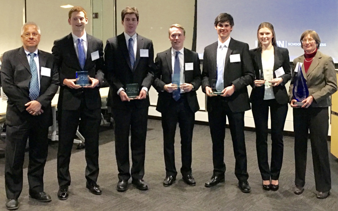 CFA Research Challenge winning team with mentors. Pictured L to R: faculty mentor Chris Wilkos, finance students Tom MacLean, Tommy Stodolski, Sean Phelan, Louis Beck, and Anna Pojawis, and industry mentor Leslie White. (Lisa Piker/Cigna)
