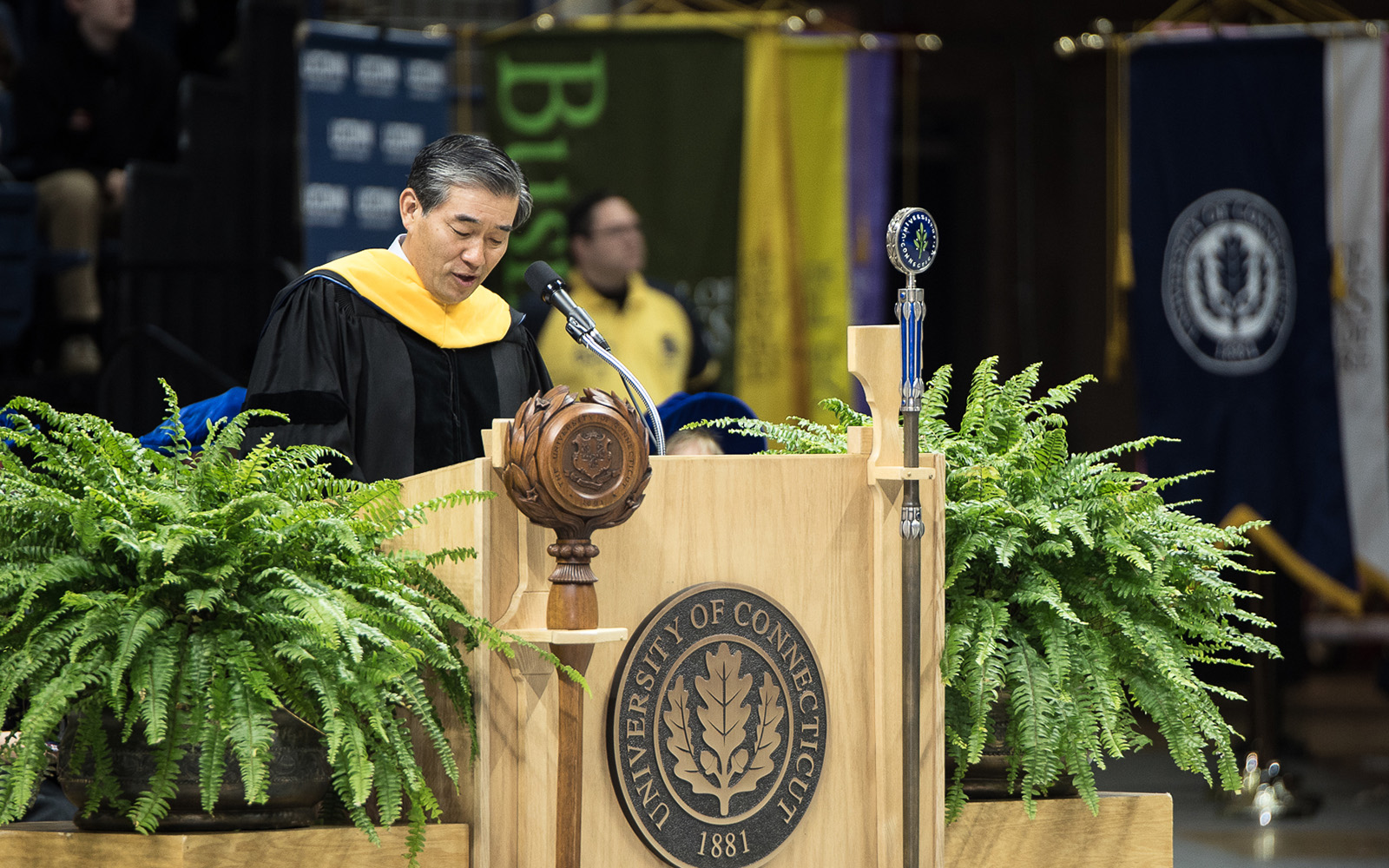 John Y. Kim '87 MBA, president and CIO of New York Life, offers advice to School of Business graduates during commencement on May 8. (Nathan Oldham/UConn School of Business)