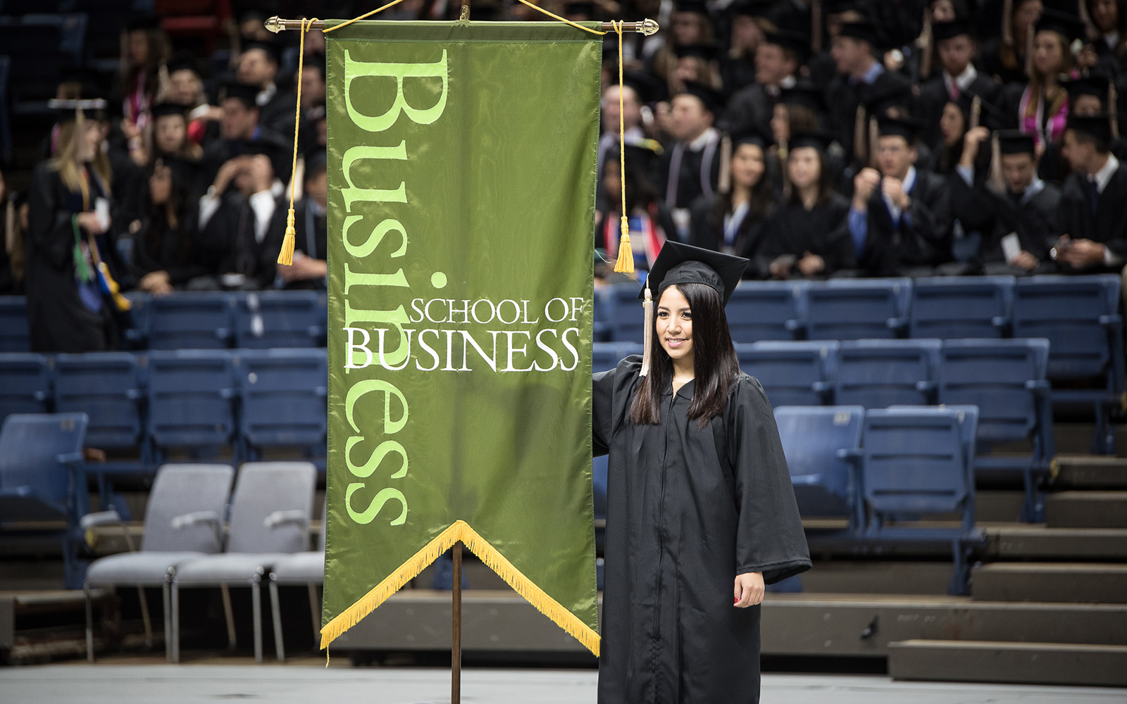 Andrea Jimenez at the 2016 UConn School of Business undergraduate commencement ceremony. (Nathan Oldham/UConn School of Business)