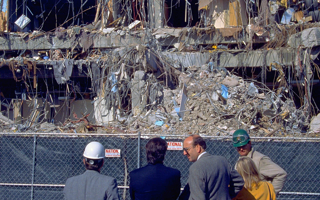 Northridge, California - January 19, 1994: Experts survey office building with one side entirely collapsed from the Martin Luther King Day earthquake. (iStock)