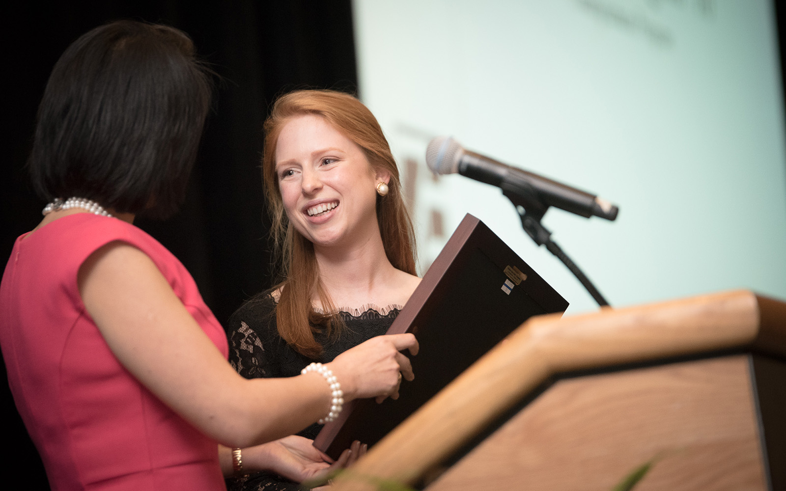 Associate Dean of Research Sulin Ba presents Emily Vasington '16 with her Hall of Fame award. (Nathan Oldham/UConn School of Business)