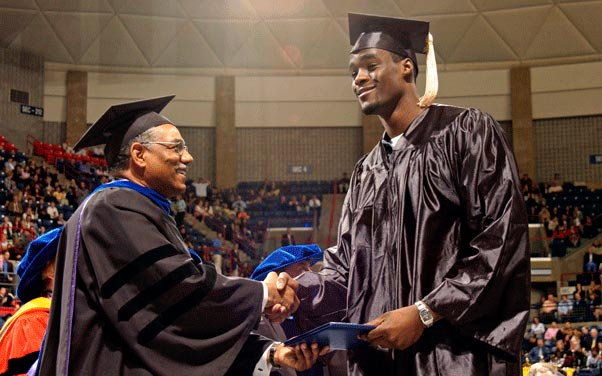 Emeka Okafor receives his diploma from former School of Business Dean Curt Hunter during Commencement ceremonies at Gampel Pavilion in May 2004. (Ryan McKee/NCAA Photos)