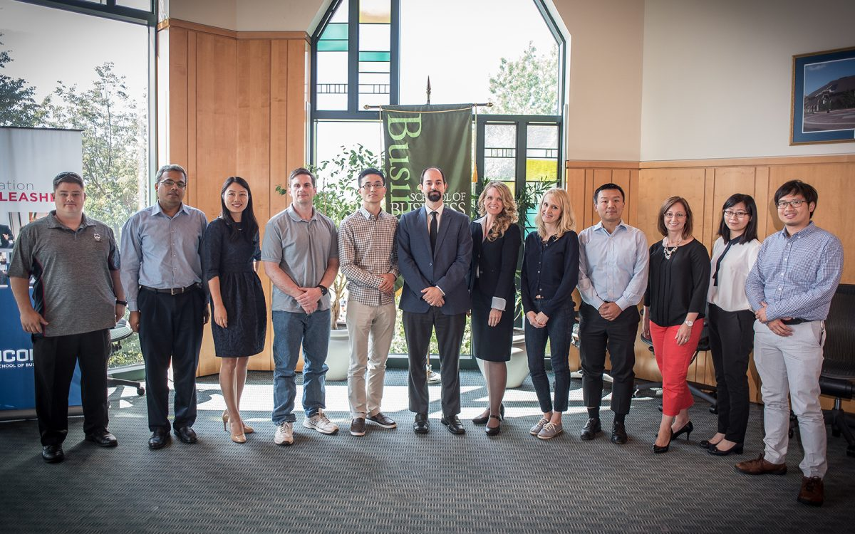 Fourteen new faculty members join the UConn School of Business for the Fall 2016 semester. (Nathan Oldham/UConn School of Business)