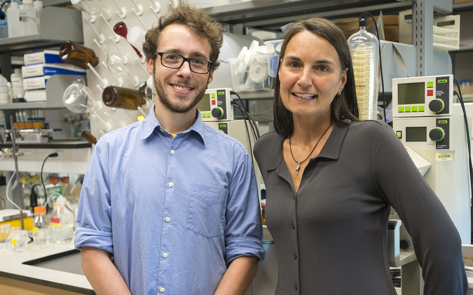 UConn scientists marine geochemist Penny Vlahos, right, and graduate assistant Joe Warren are commercializing a new technology they developed to more easily measure contaminants in water. (Sean Flynn/UConn Photo)
