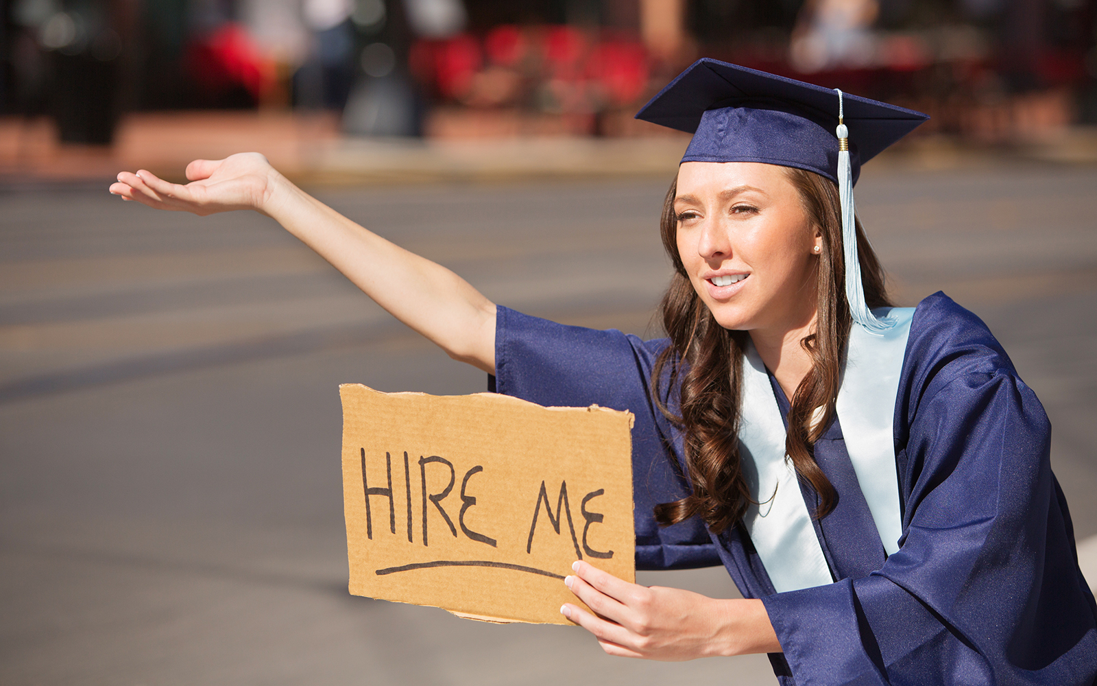 Dean's Blog: Graduate with Hire Me Sign Correcting a Common Misconception About College Graduates and Their Prospects