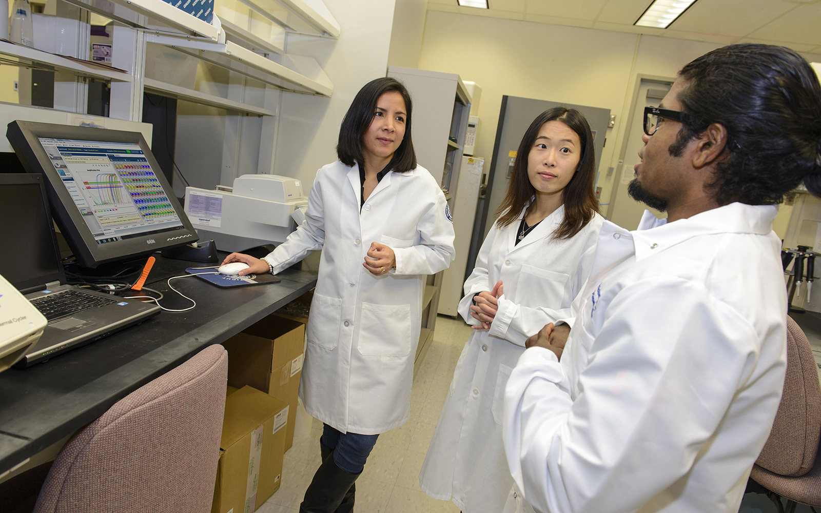 Denisse Tafur, Huakang Huang and Dinesh Babu Uthaya Kumar are UConn Graduate School students studying biomedical science who completed advanced training in translational research at the NIH's Clinical Center this summer (UConn Health/Janine Gelineau).