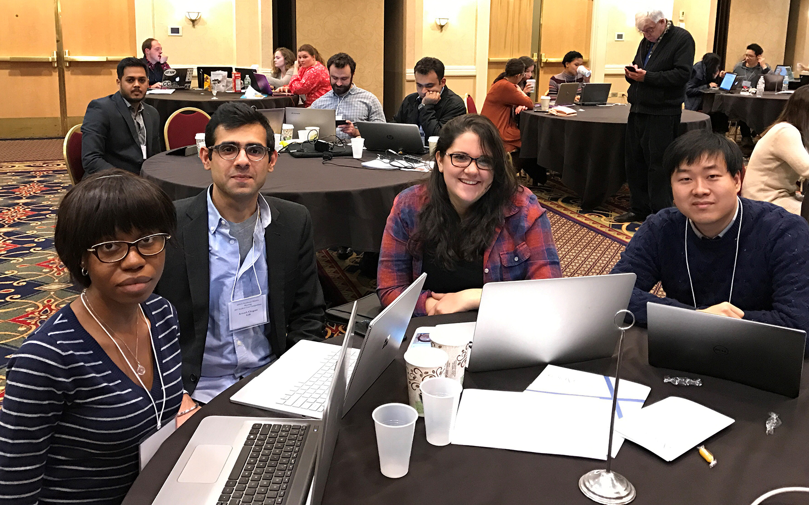 Enuma Ezeife, Avinash Chugani, Alexandra Buchanan and Ted Jin made up the team of UConn graduate studetns who won the APICS Northeast Student Competition (Ryan Baldassario/UConn School of Business)