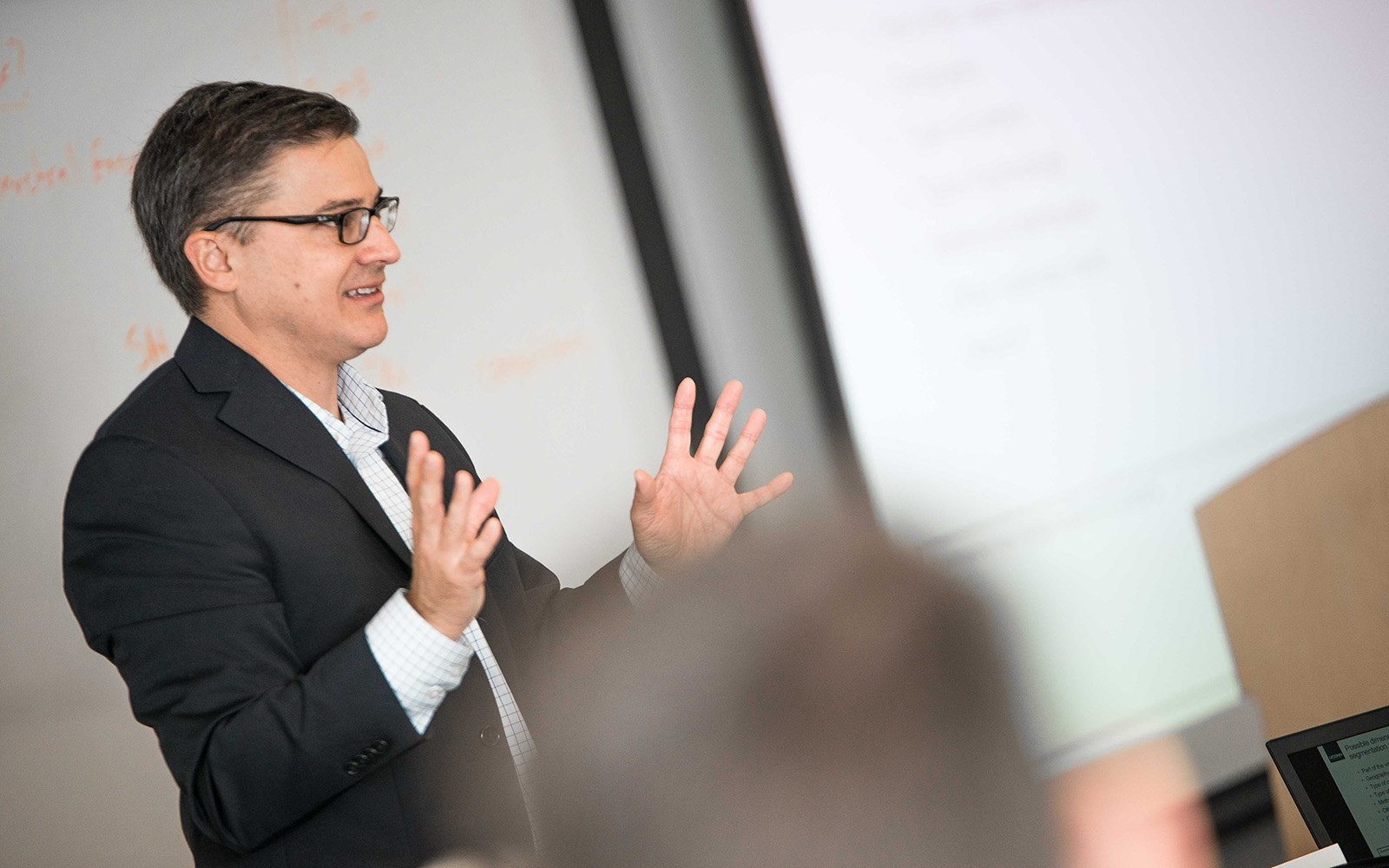 Professor Greg Reilly, teaching an Executive MBA course in Hartford, Conn. (Nathan Oldham/UConn School of Business)