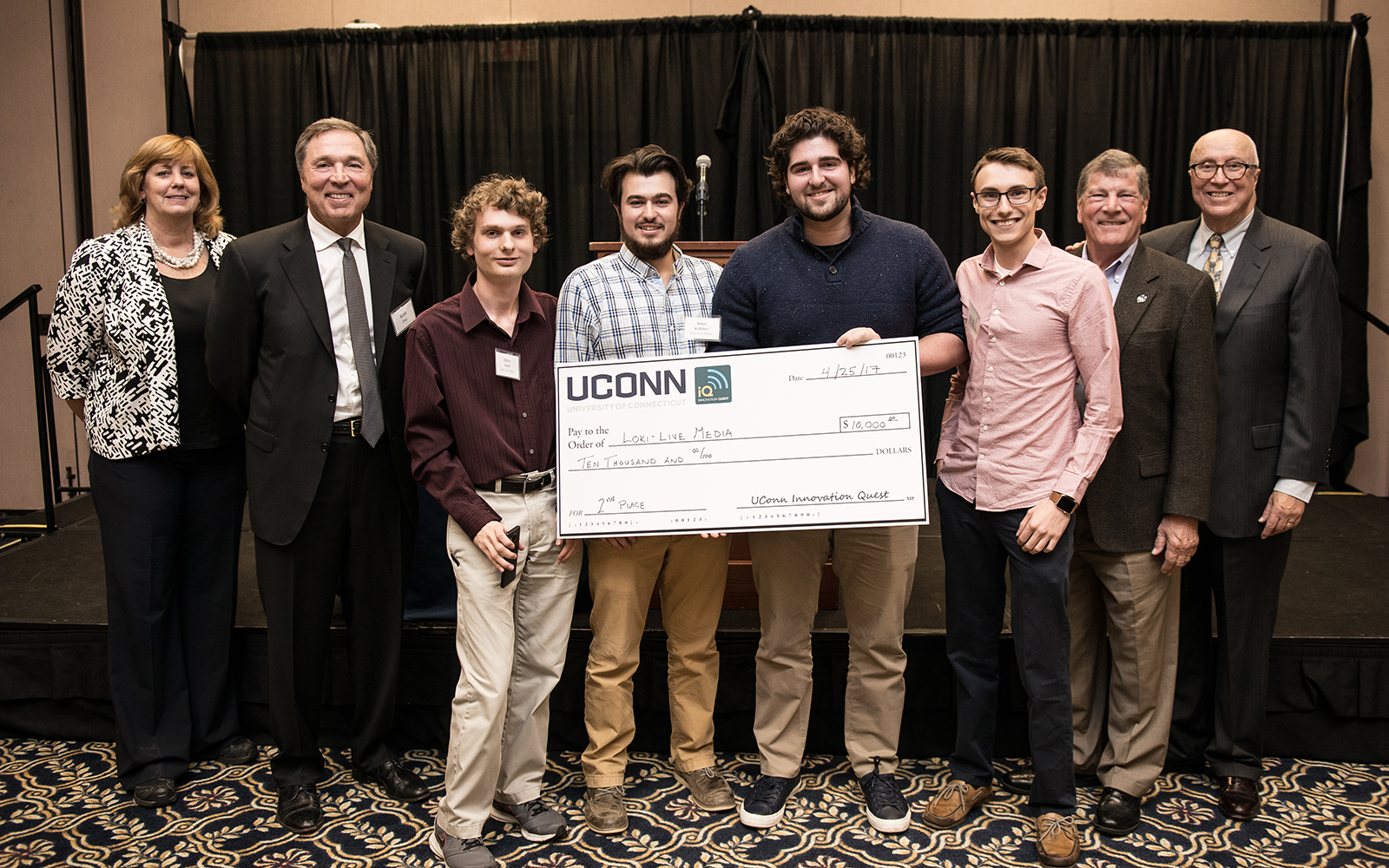 From left: Management Department Head Lucy Gilson, Alumnus Keith Fox '80, LOKI team members Jeffrey Santi, Brian Kelleher, Andrew Ginzberg, and Case Polen; School of Business Dean John Elliott, and Management Professor Rich Dino (Nathan Oldham/UConn School of Business)