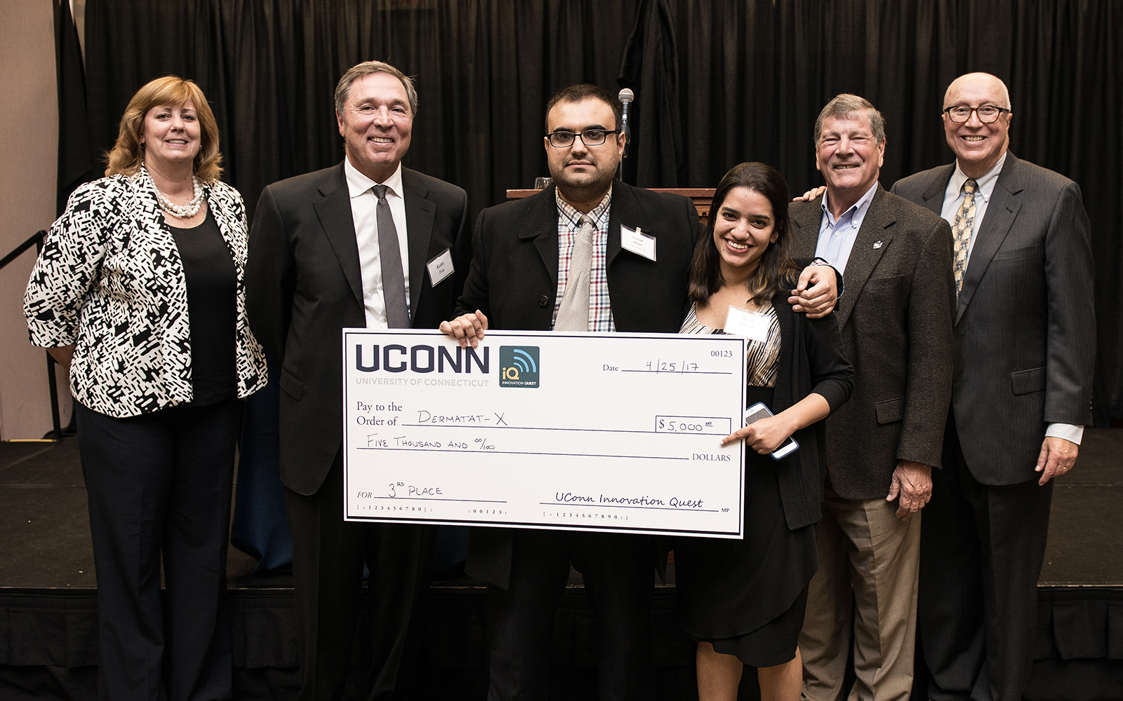 From left: Management Department Head Lucy Gilson, Alumnus Keith Fox '80, Dermatat-X team members Faizan Khan and Ishita Banerjee, School of Business Dean John Elliott, and Management Professor Rich Dino (Nathan Oldham/UConn School of Business)
