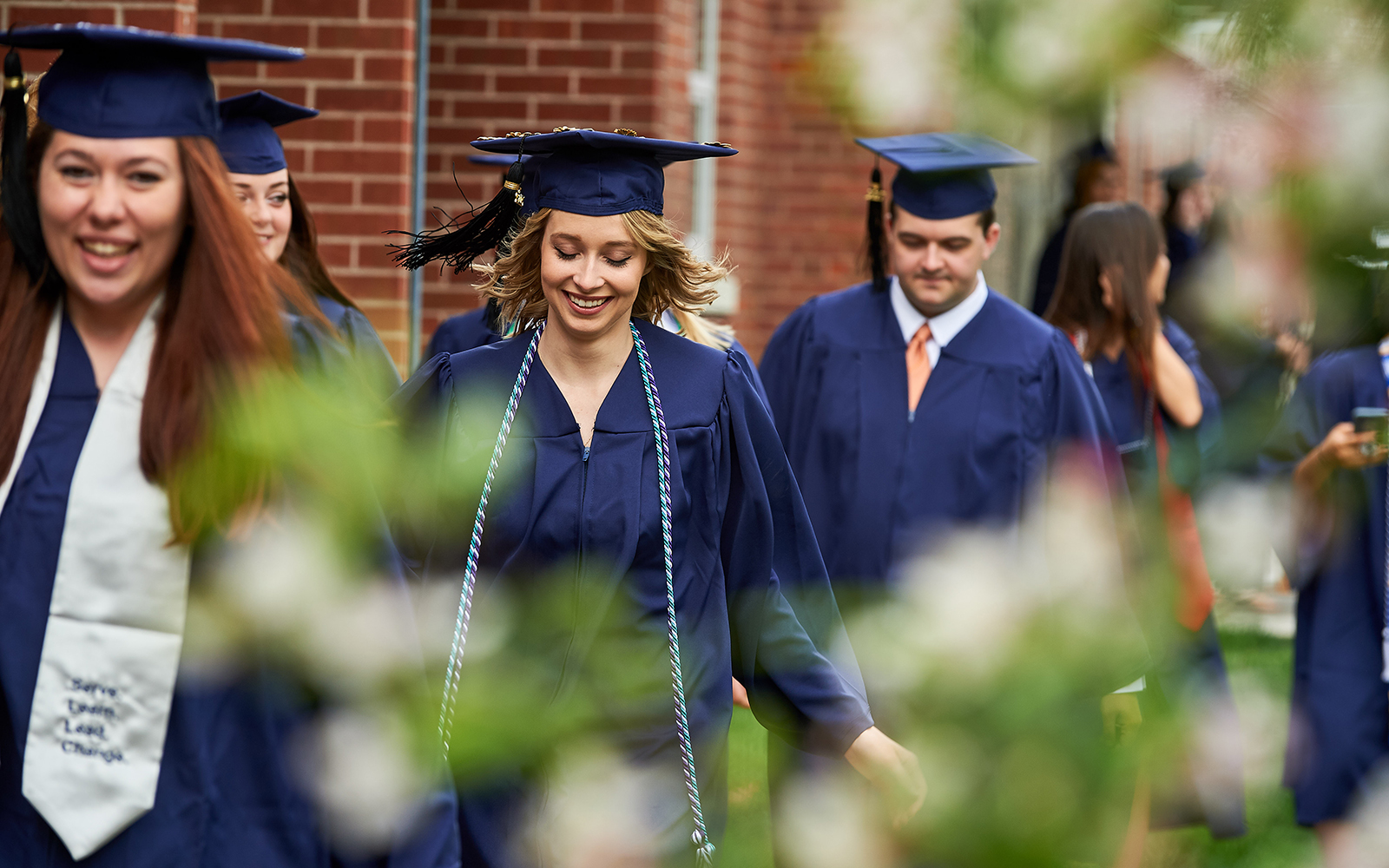 Students walk outside the Greer Field House before the College of Liberal Arts and Sciences Commencement ceremony on May 7, 2017. (Peter Morenus/UConn Photo)