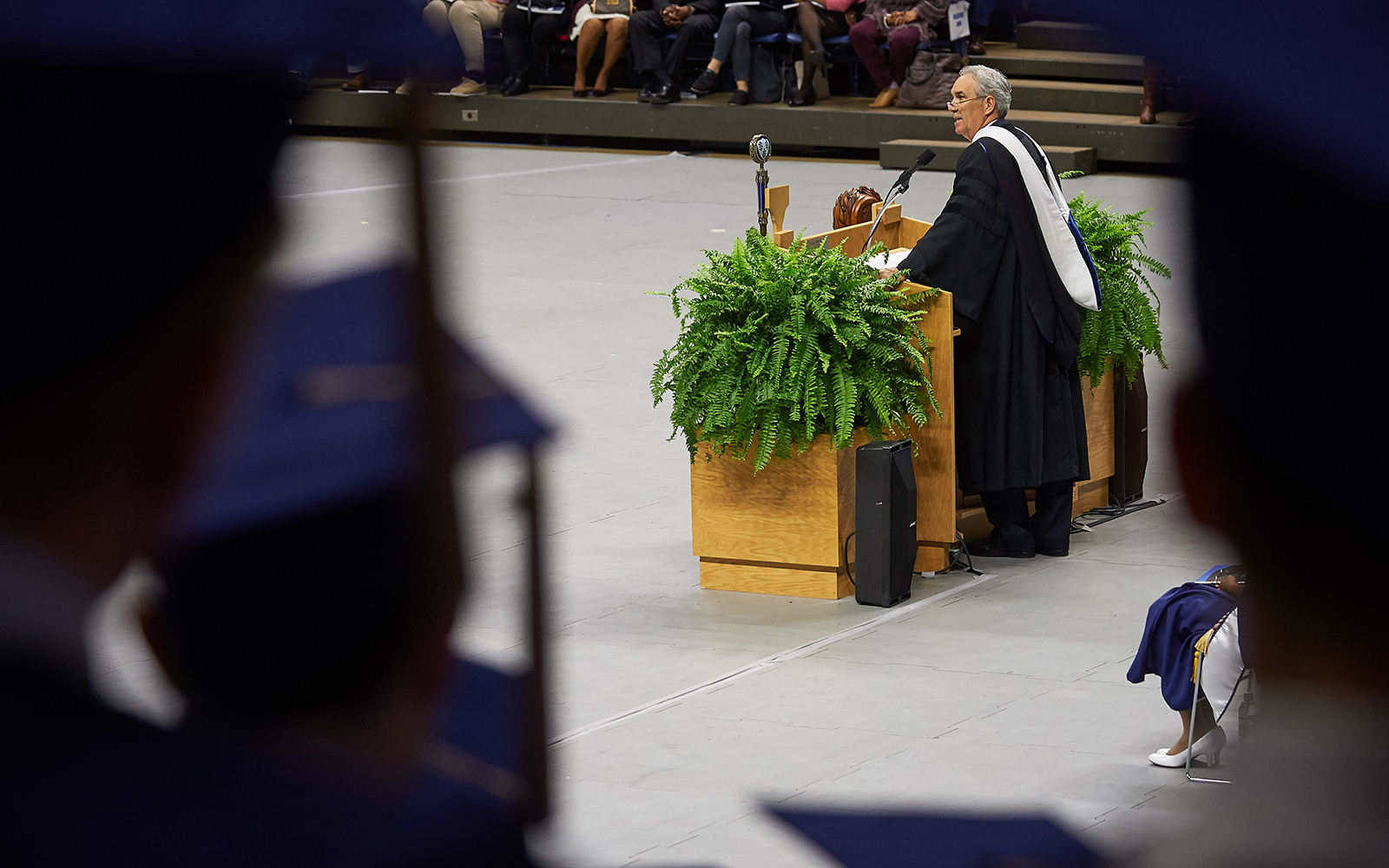 Douglas Elliot '82 (BUS) gives the address during the School of Business Commencement ceremony at Gampel Pavilion on May 7, 2017. (Peter Morenus/UConn Photo)