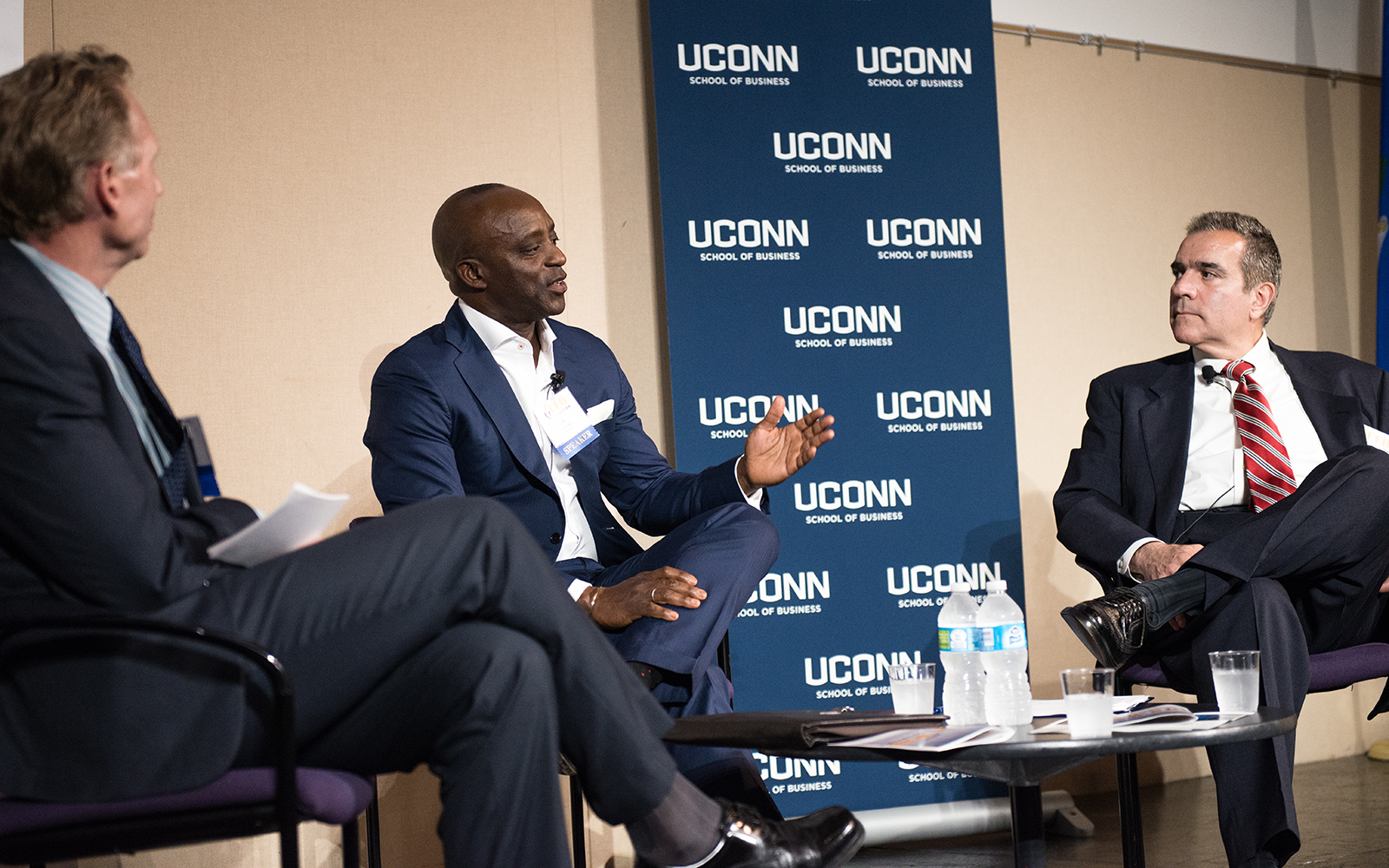 From left: Mark Fagan, office managing partner at Citrin Cooperman, Oni Chukwu, CEO and member of the board of directors at etouches, and John J. Preli, director of regulatory management and governance for The Weather Co. (Nathan Oldham/UConn School of Business)