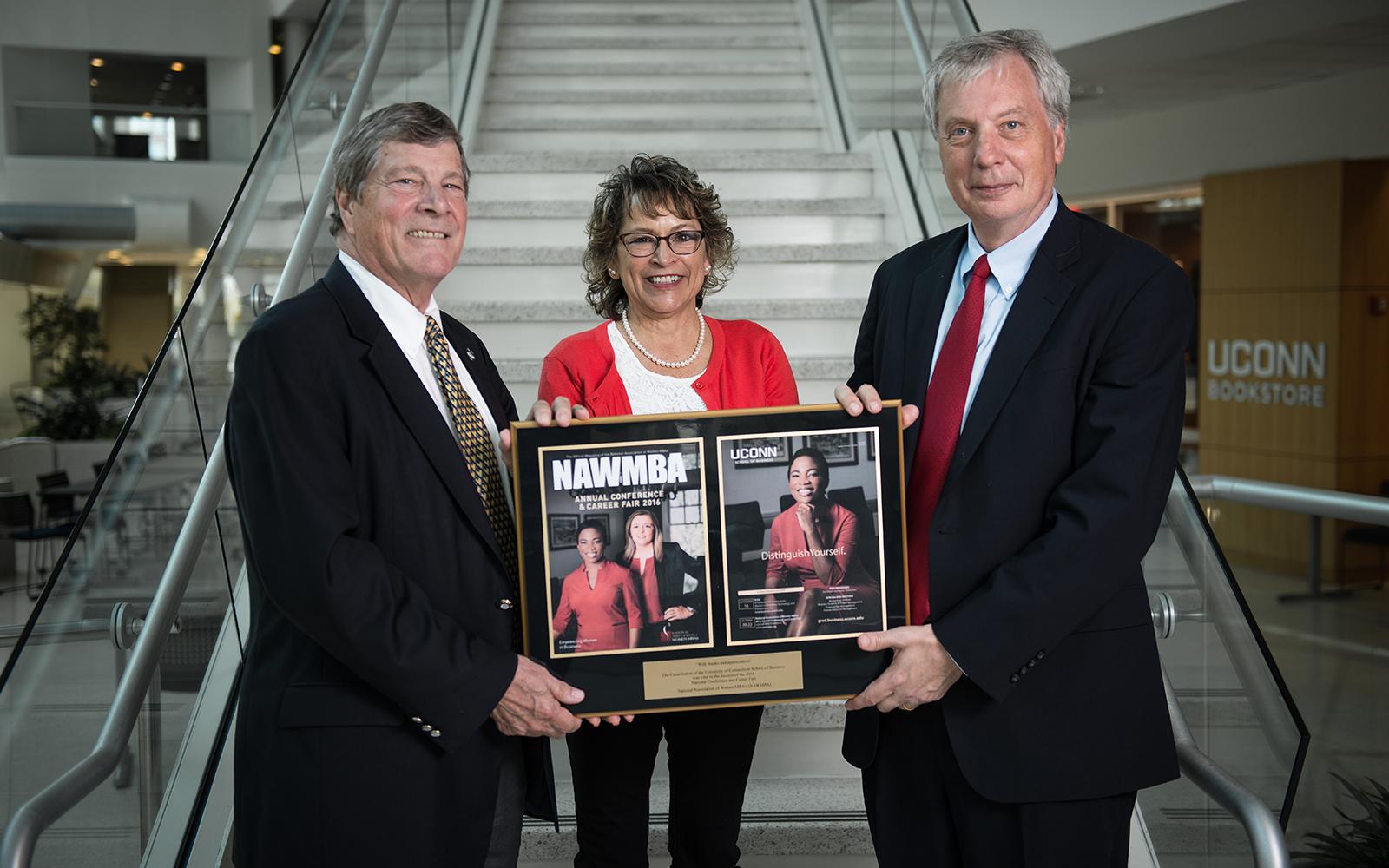 NAWMBA plaque presented to John Elliott, Marlys Rizzi, John Knopf (Nathan Oldham/UConn School of Business)
