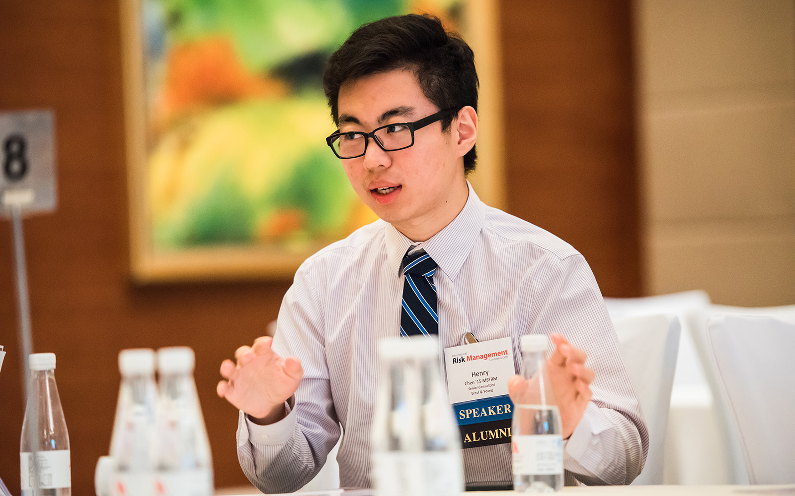 Henry Chen '15 MSFRM, Senior Consultant at Ernst & Young, speaks at the first annual International Risk Conference (Katherine Ruiz/UConn School of Business)