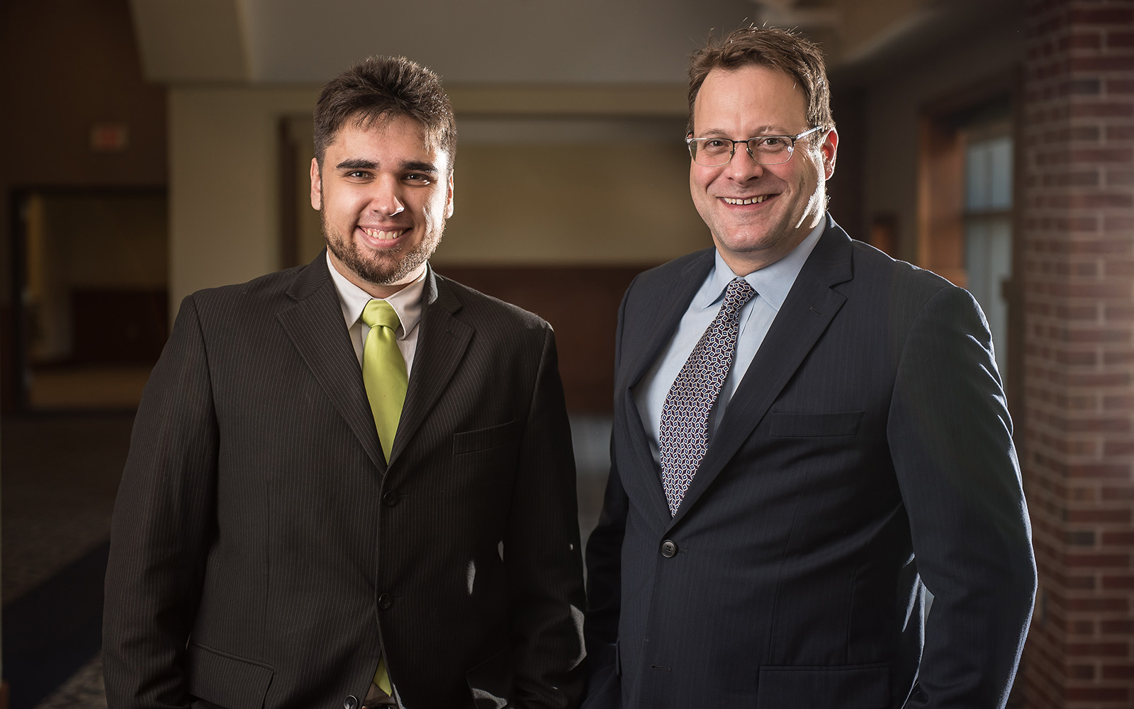 Kostyantyn Partola, an engineering Ph.D. candidate, poses for a photo with adviser Thomas Geer prior to the start of the Wolff competition. Missing from photo is Professsor George Lykotrafitis from the School of Engineering. (Nathan Oldham/UConn School of Business)