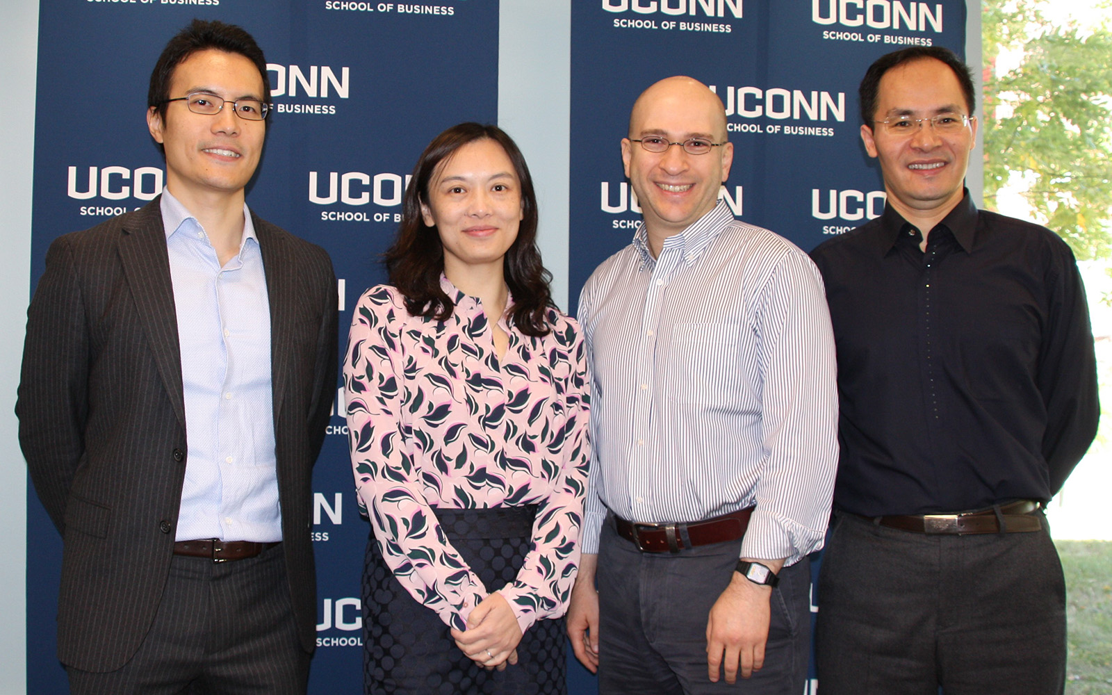 From left: Shijie Lu, Ying Xie, Yakov Bart, and Xueming Luo. (Nancy White/UConn School of Business)