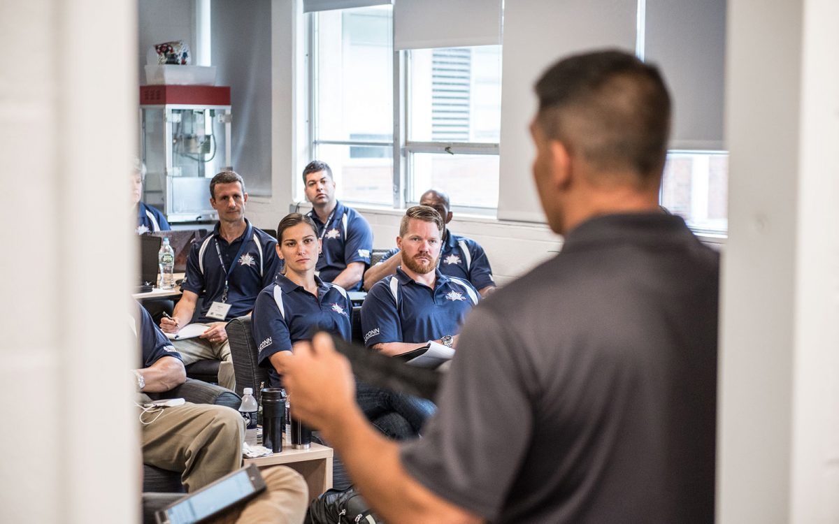 The EBV hosts up to 25 U.S. military veterans during an annual, 10-day program that prepares them to become entrepreneurs. Pictured above, EBV Class of 2017 veterans in class. (Nathan Oldham/UConn School of Business)