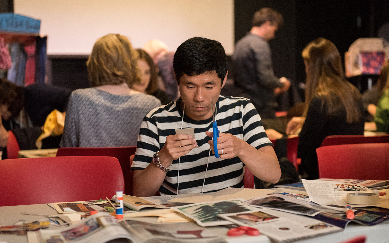 "To spur creativity during the closing session, conference participants were given minimal resources such as old magazines and cardboard boxes, with which they created ""toy theatres"" at the Ballard Puppetry Museum. (Devin Basdekian/UConn School of Business)"