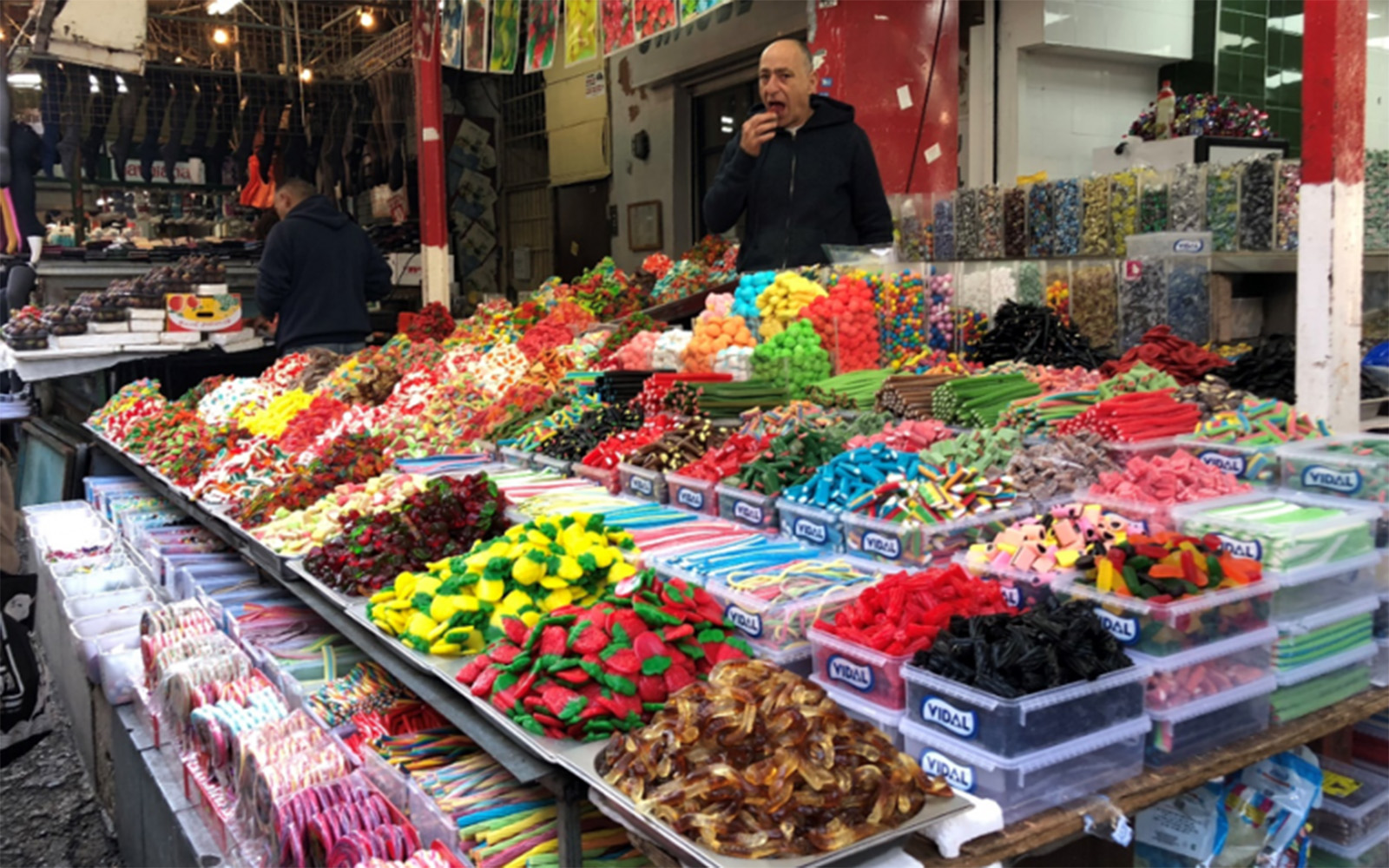 Vendor selling candy in Carmel Market in Tel Aviv (Jonathan Hague/UConn School of Law)