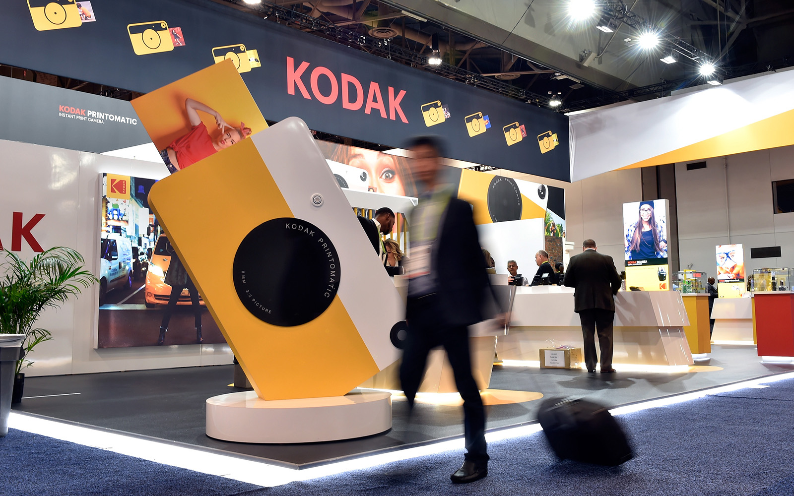 An attendee walks by the Kodak booth during CES 2018 at the Las Vegas Convention Center. CES is the world's largest annual consumer technology trade show. (David Becker/Getty Images)