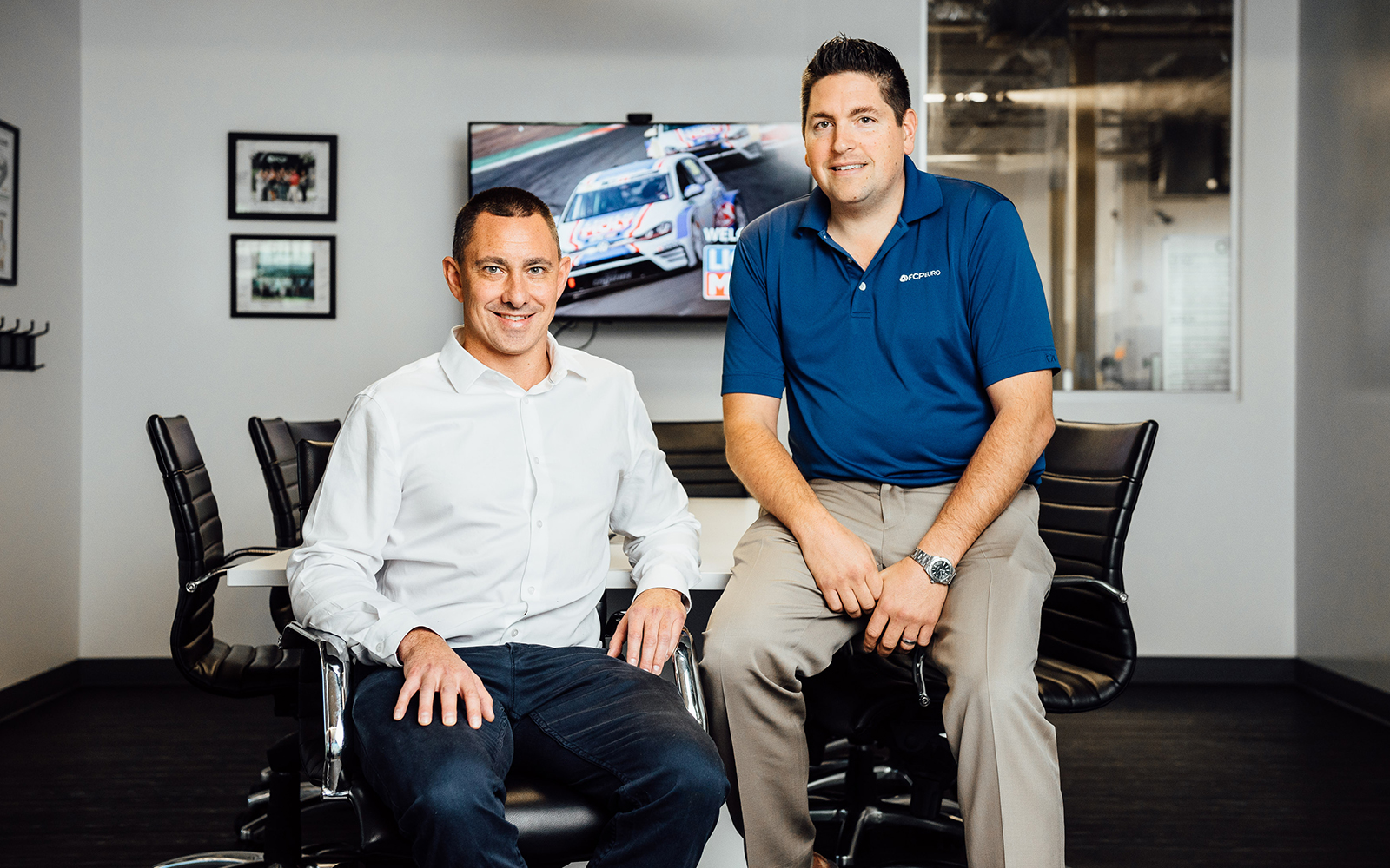 Alumnus Scott Drozd and business partner Nick Bauer pose for a photo at the headquarters of their highly successful FCP Euro auto parts company in Milford. (Nathan Oldham/UConn School of Business)