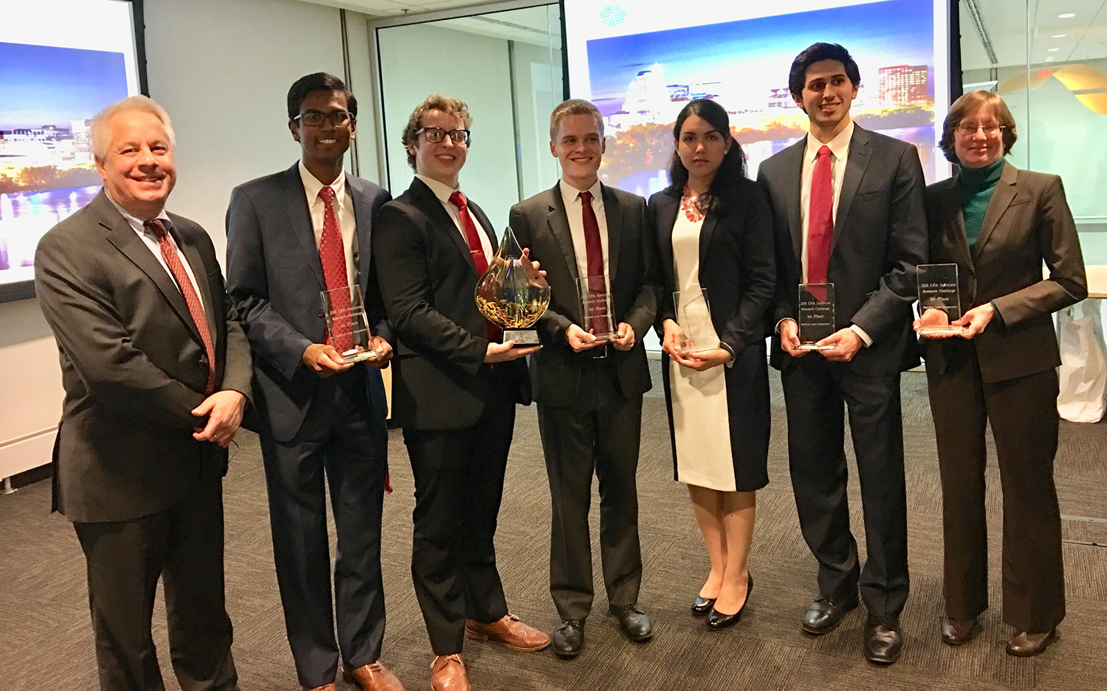 Pictured, from left: Chris Wilkos, CFA (advisor), Vivek Tedla '18, Jack Leyland '18, Bartosz Walas '18, Ana Walas '18, Anthony Mottolese '18 and Leslie White, CFA (industry advisor). (Ana Walas/UConn School of Business)