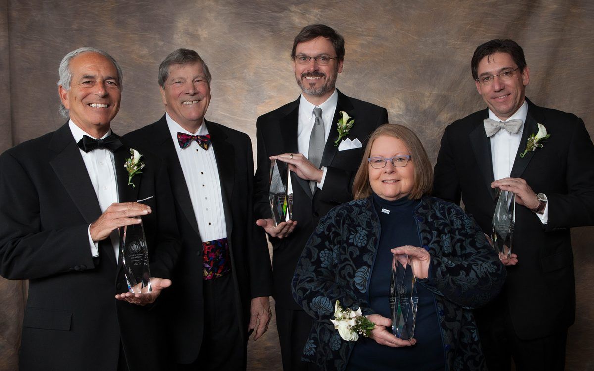 From left: David Acampora '79; Dean John A. Elliott; Timothy Curt '84, Gayle A. Russell '88 MBA, '95 Ph.D. and Christopher Lafond '87. (Thomas Hurlbut Photography)
