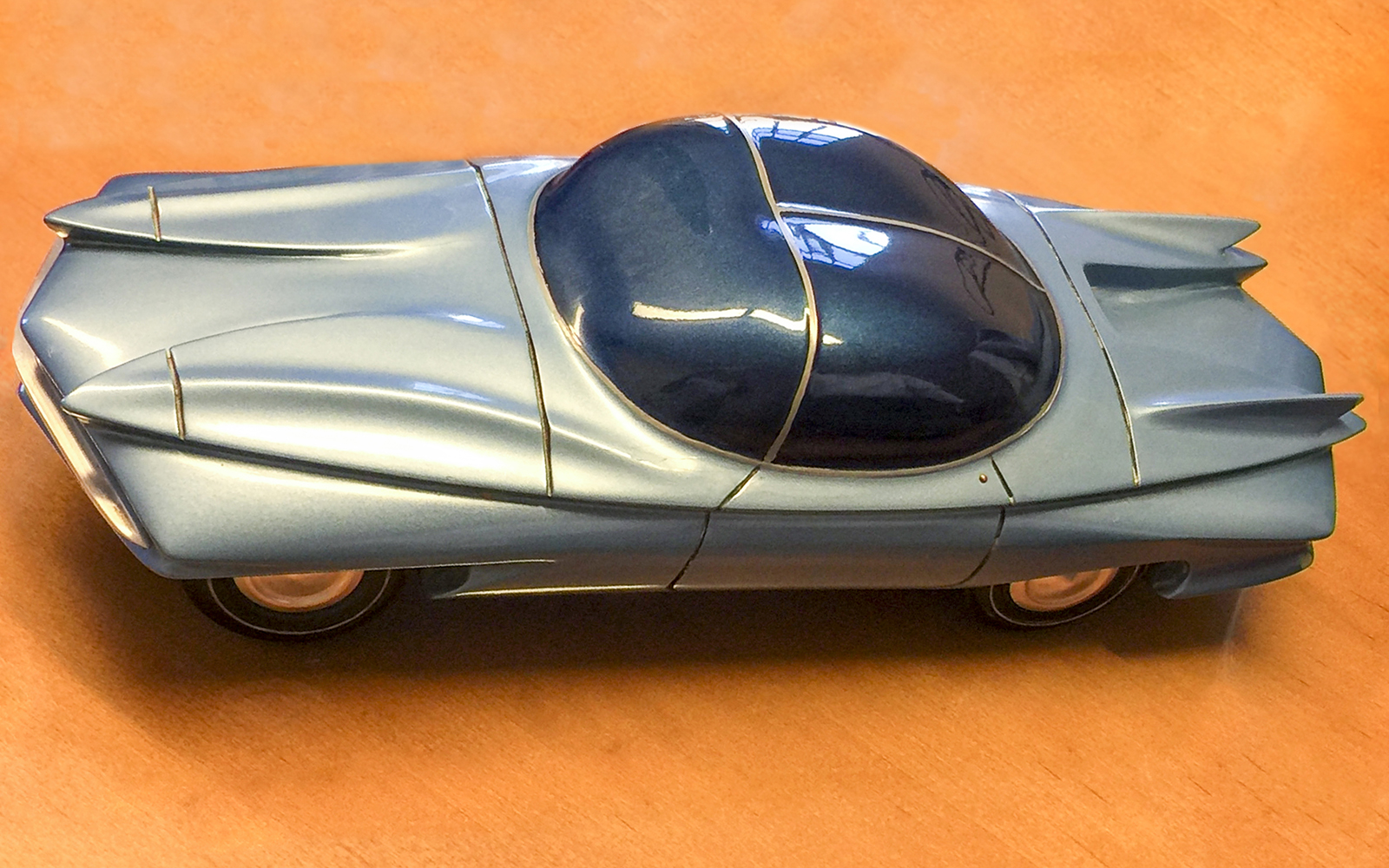 Through many years of teaching accounting, much-loved professor Dick Kochanek never forgot his teenage dream of being an artist. He won an award from GM as a teenager for this model car, which he designed, carved, and painted with many coats.