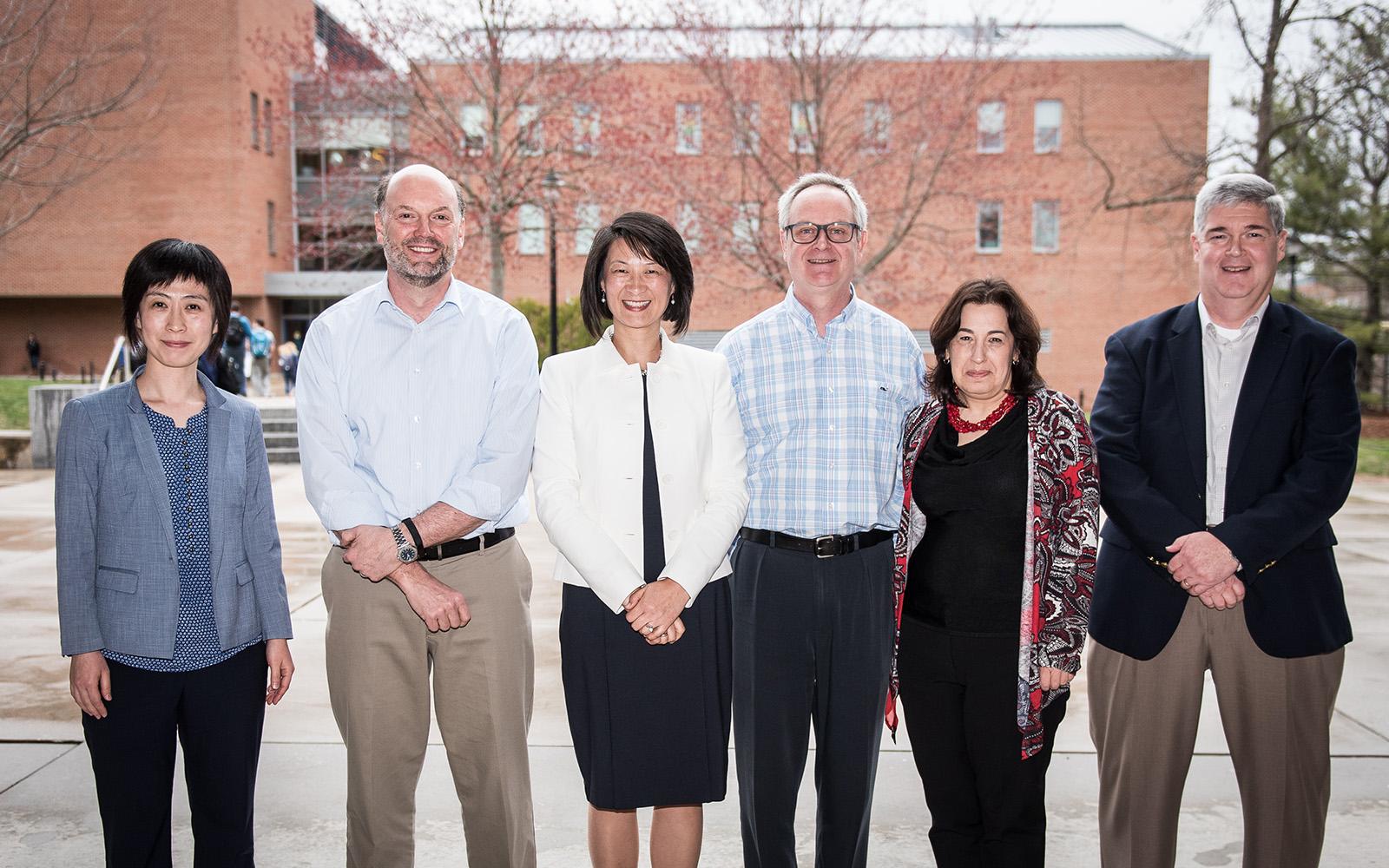 From left: Faculty award winners Xinxin Li, John Mathieu, Sulin Ba, Jan Stallaert, Nora Madjar, and David Papandria. (Nathan Oldham/UConn School of Business)