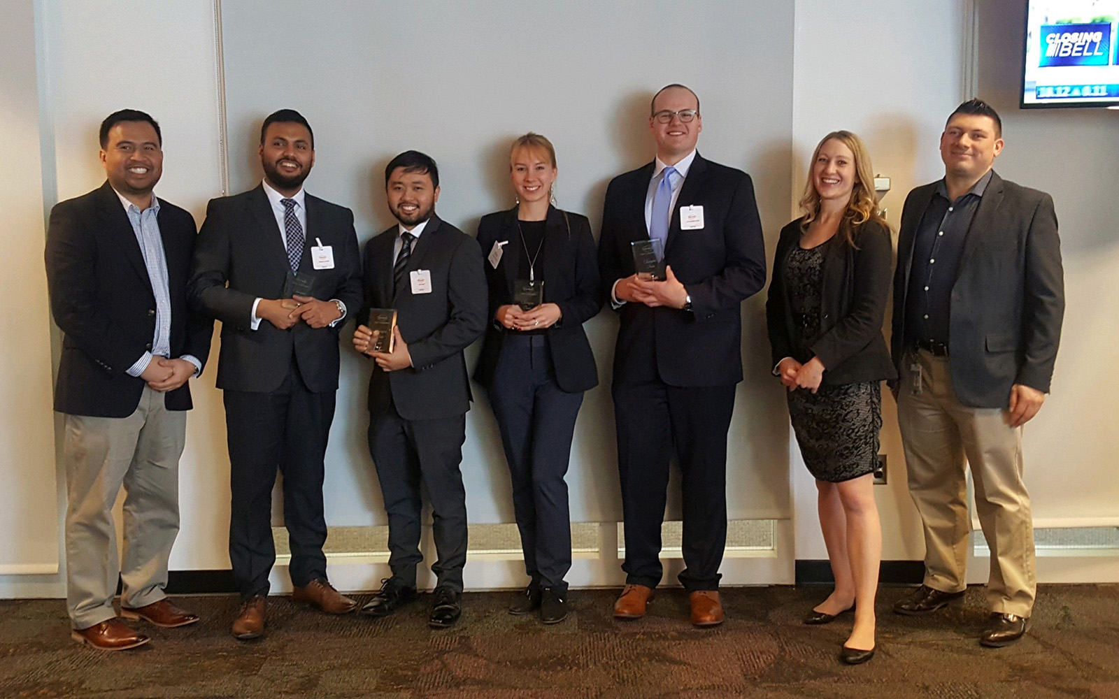 Kseniia Poiarkina '18 MBA (center) poses for a photo with teammates and Henkel representatives following her team's case competition win. (Kseniia Poiarkina '18 MBA/UConn School of Business)