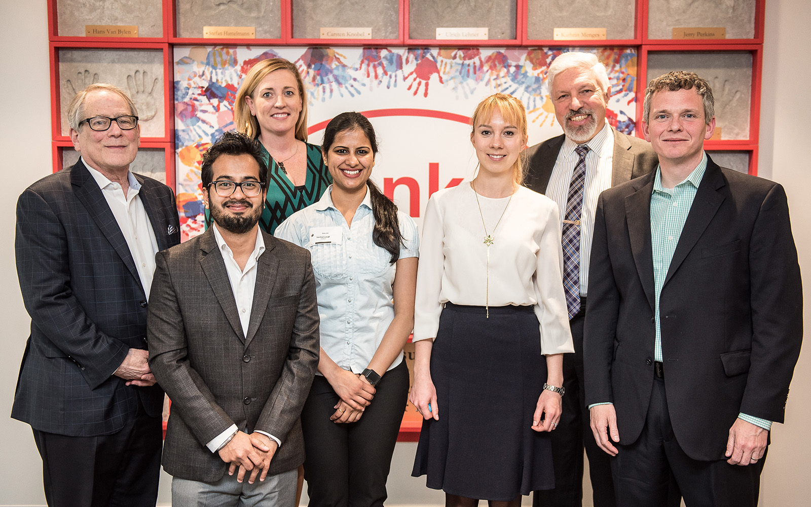 As part of UConn's Experiential Learning Collaborative (ELC), graduate students worked with Henkel Corp. this spring to identify new opportunities for business growth and competitive advantage. Above are some of the participants, including, from left: Martin Donner, ELC project mentor; Niraj Sharma '18 MSBAPM; Kimberly Newton, a vice president at Henkel; Snehal Singh '18 MSBAPM; Kseniia Poirkina '18 MBA; Greg Kivenzor, ELC director, and Brad Wade, director at Henkel. (Nathan Oldham/UConn School of Business)