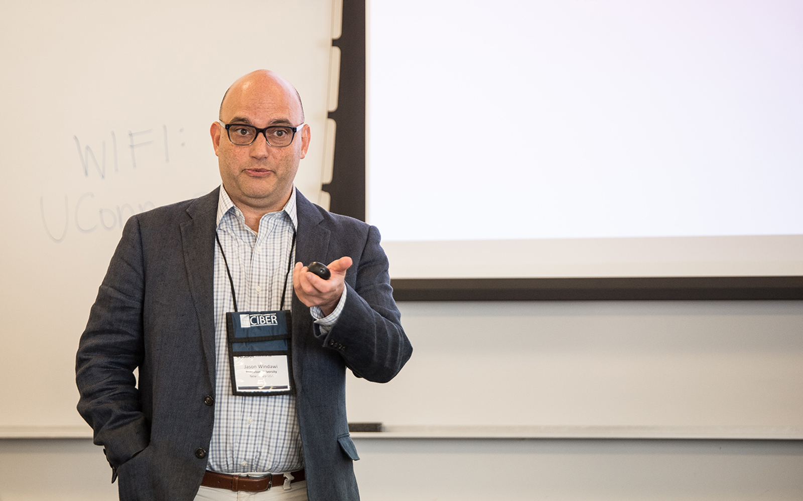 "A. Jason Windawi, a Ph.D. student at Princeton University, explained his research about ""Building on the Blockchain: The Interplay of Organization and Technology in Emergent Field.'' (Nathan Oldham/UConn School of Business)"