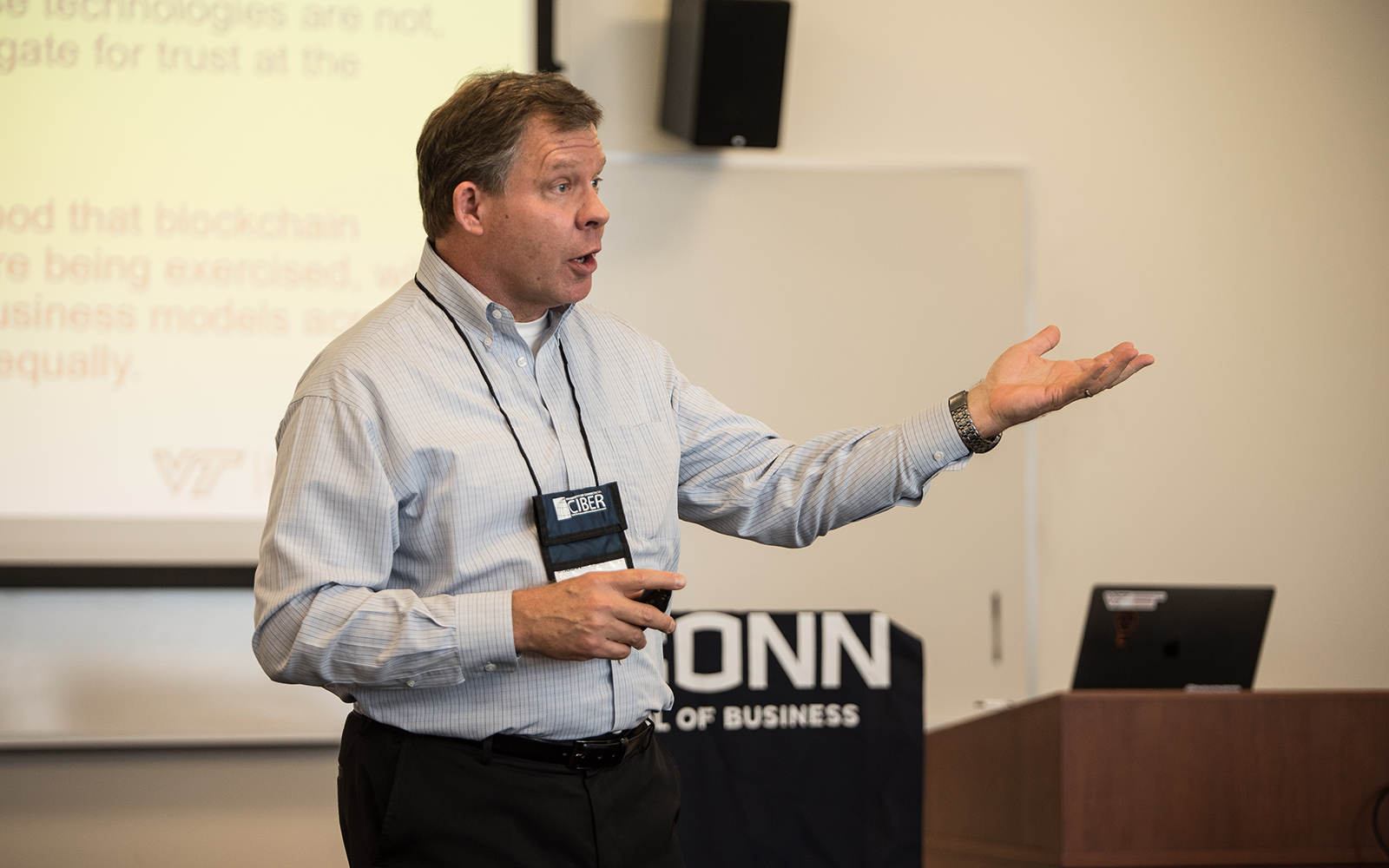 Mark Mondry, a professor at Virginia Tech, discusses his research on Blockchain and trust concerns in transactional organizations. (Nathan Oldham/UConn School of Business)