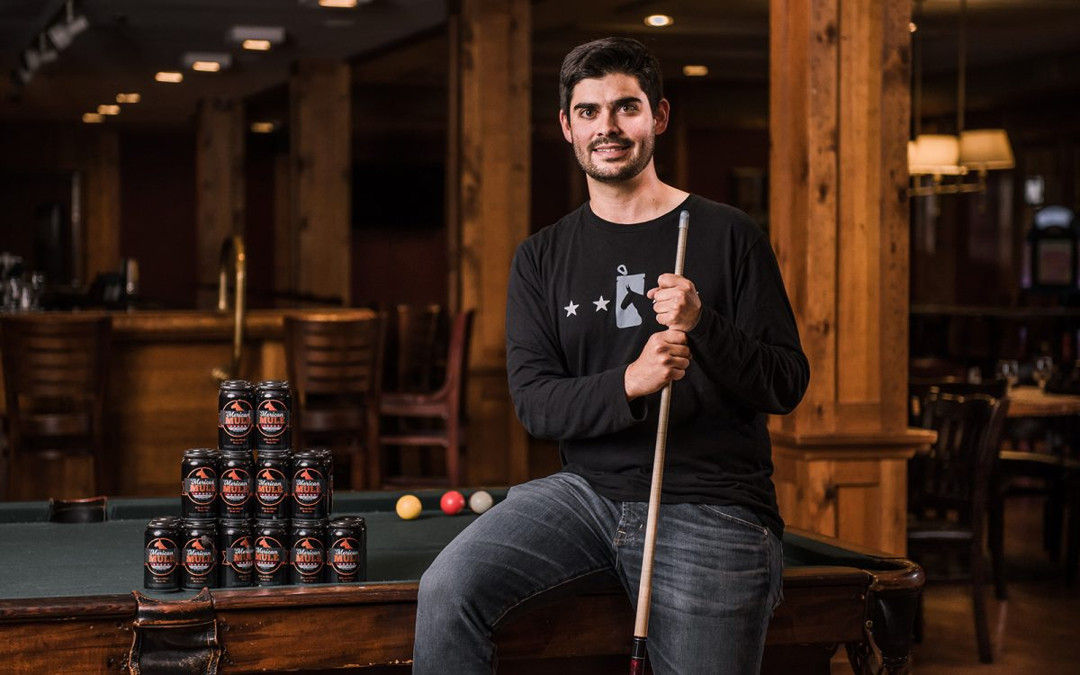 Dean Mahoney '09, pictured above, co-founded 'Merican Mule. He is spearheading distribution of his company's namesake, an alcoholic beverage inspired by the Moscow Mule. (Nathan Oldham/UConn School of Business)