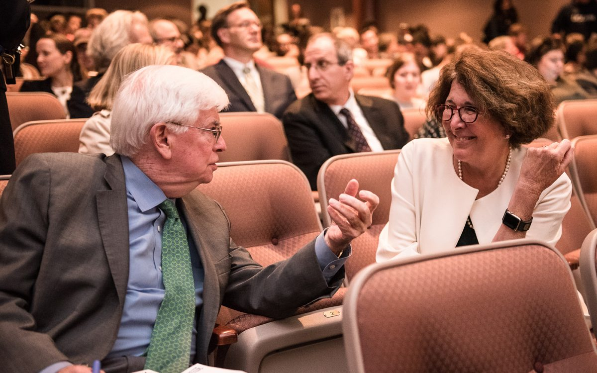 Amy Domini, the keynote speaker for the Business & Human Hights Initative Symposium, speaks with former U.S. Senator Christopher Dodd.