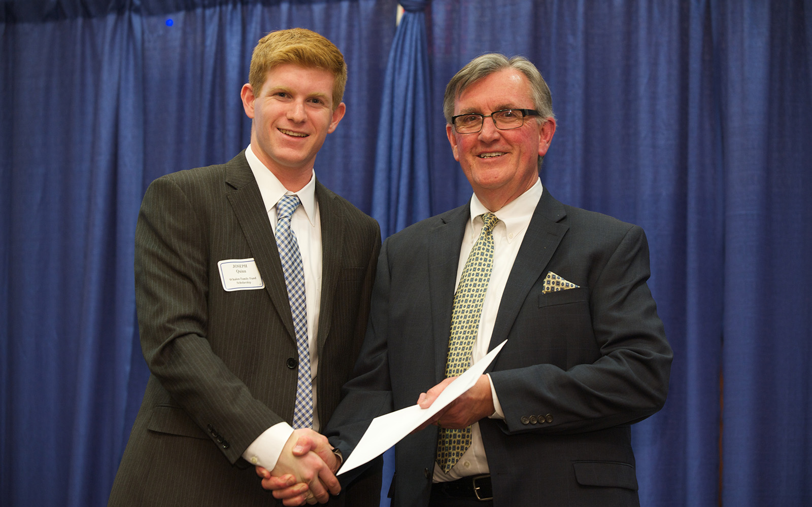 In this 2014 file photo, Professor Larry Gramling, then associate dean of Undergraduate Programs, poses with scholarship recipient Joseph Quinn during the Accounting Honors Banquet. (Kim Bova/UConn School of Business)