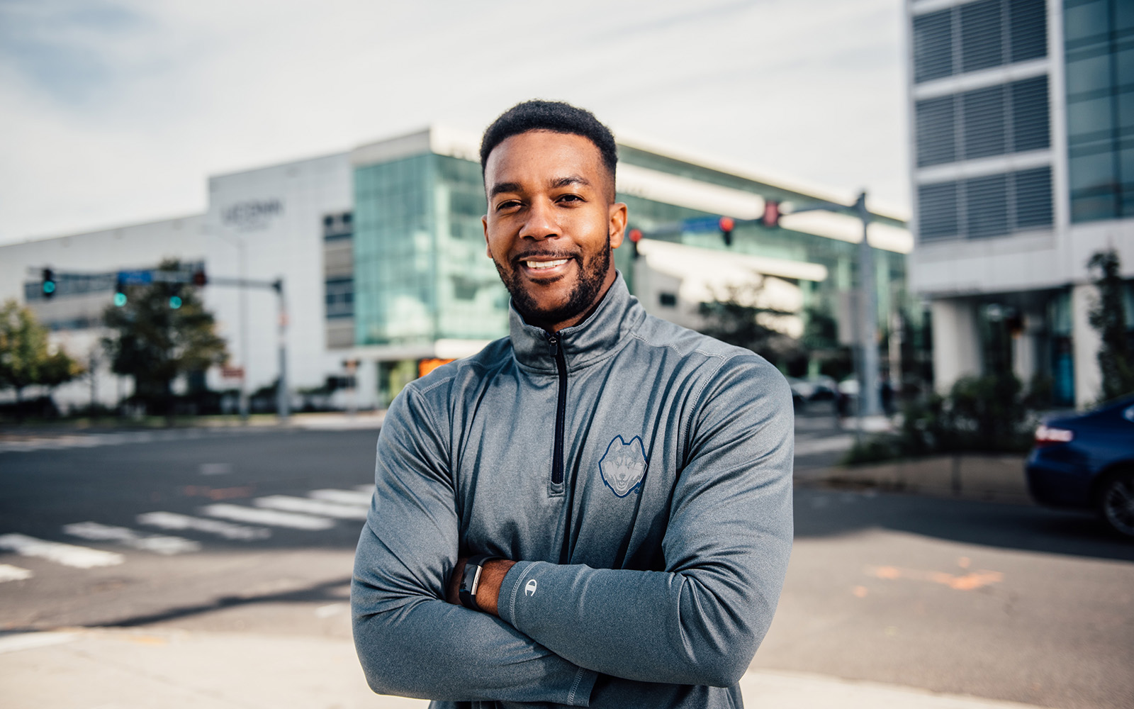 Junau Boucard '11 (above) will run in the NYC Marathon next month. He is juggling work, race training, and the Part-time MBA program at UConn Stamford. (Nathan Oldham/UConn School of business)