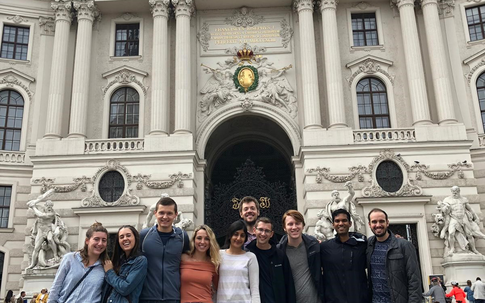 Kasia and her travel companions posing outside the Hofburg in Vienna, Austria (Kasia Kolc / UConn School of Business)