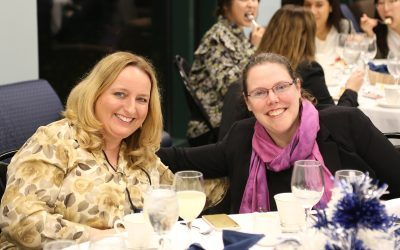 Alumna Allegra Klein, '18 MBA and Michele Metcalf, director of the CIBER program, share a light moment during the event. (Arminda Kamphausen, UConn School of Business)