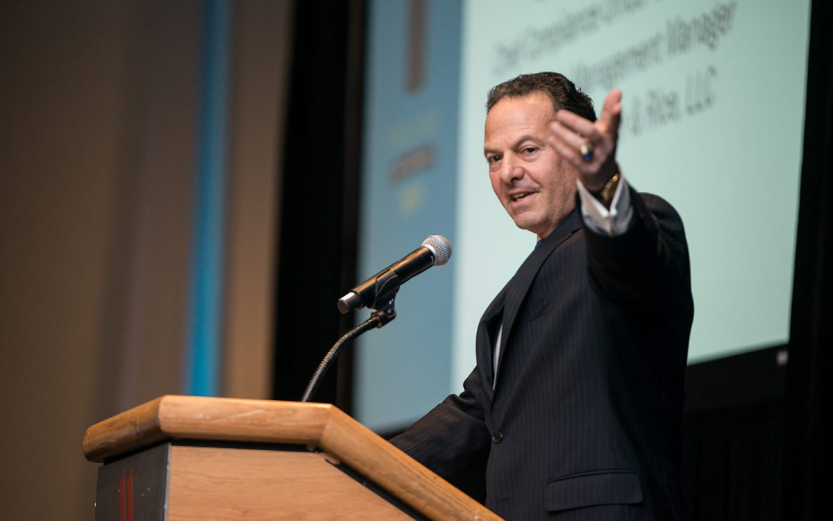 John Malfettone '77 (BUS) speaks about the importance of giving back to your alma mater, on the occasion of his induction into the School of Business Hall of Fame in 2017. (Nathan Oldham/UConn Photo)