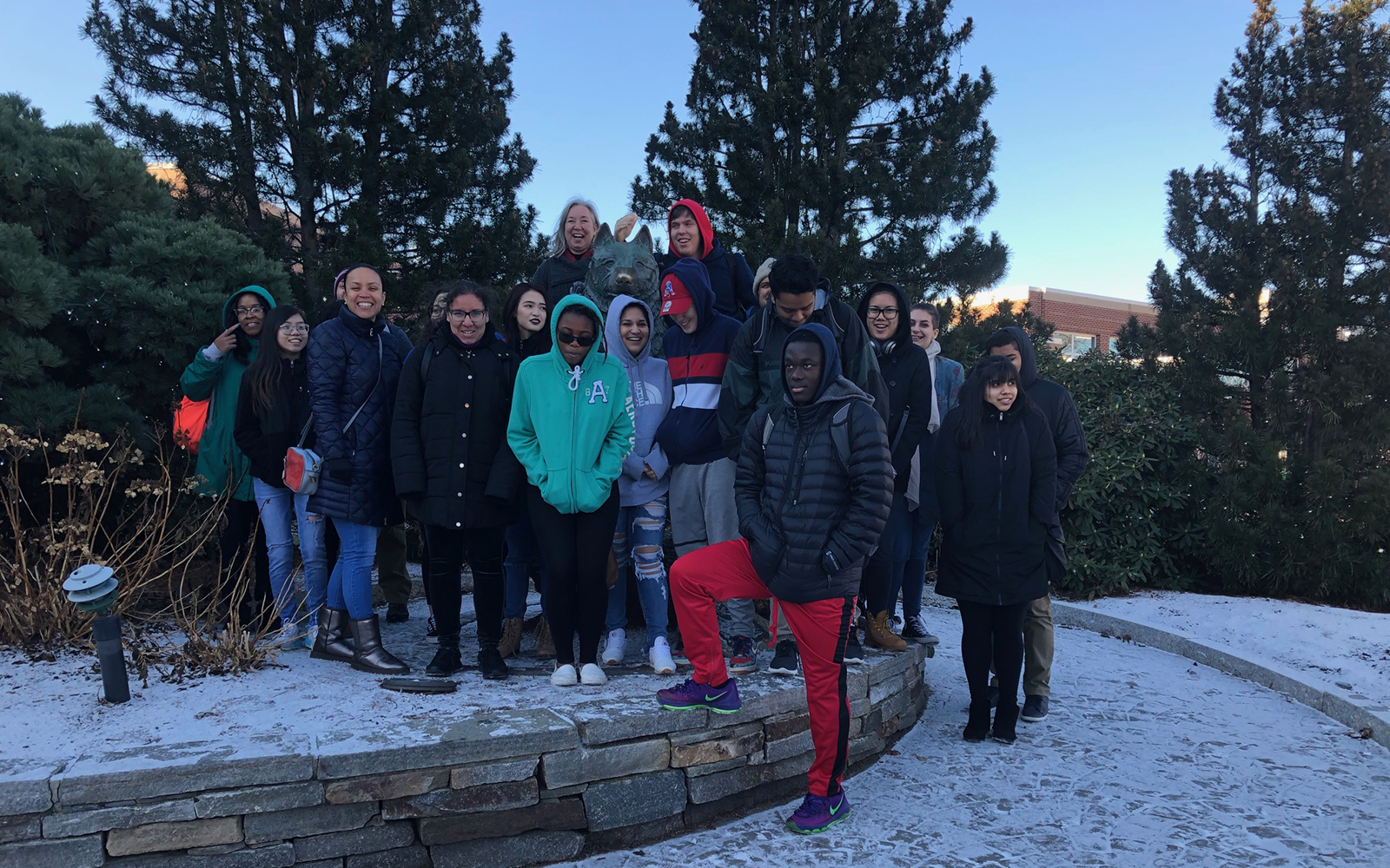 Students from Manchester High take a moment to pose with the statue of Jonathan outside of Gampel Pavilion during their recent visit to the Storrs campus.  (Arminda Kamphausen / UConn School of Business)