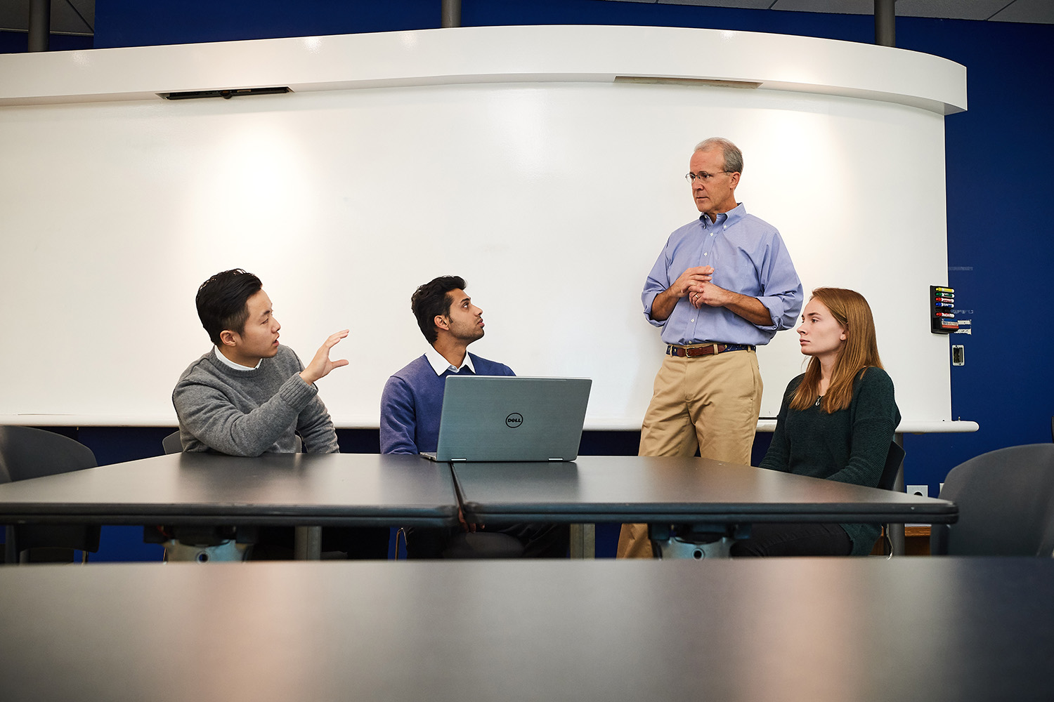Former Goldman Sachs partner Blake Mather, advisor to a new Student Managed Fund at UConn Stamford, meets with student managed fund members Di Yang, left, Anshul Manglani, both graduate students, and Lindsey Lozyniak '19 (BUS). (Peter Morenus/UConn Photo)