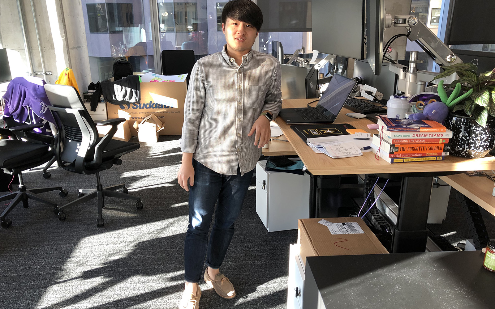 Jimmy Tang '11 (BUS), in his office at the Twitch headquarters in San Francisco. (Photo courtesy of Jimmy Tang)