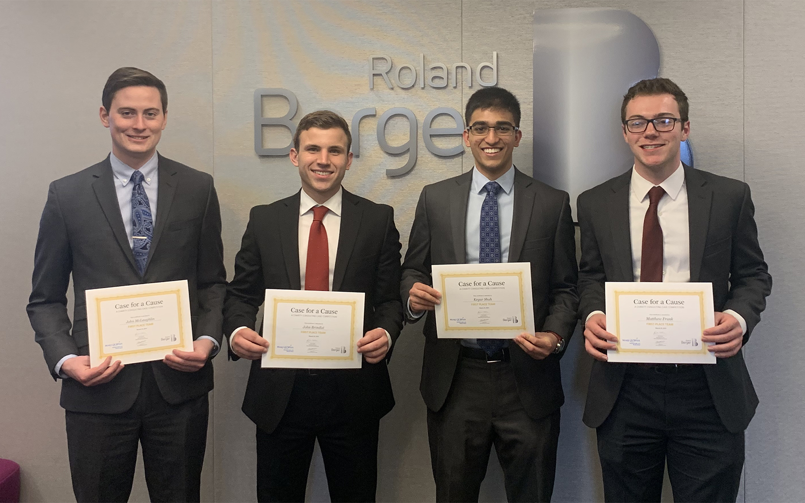 "Left to right, John McLaughlin, John Brindisi, Keyur Shah, and Matthew Frank accepting their awards at the ""Case for a Cause"" competition (Photo courtesy of John McLaughlin)"