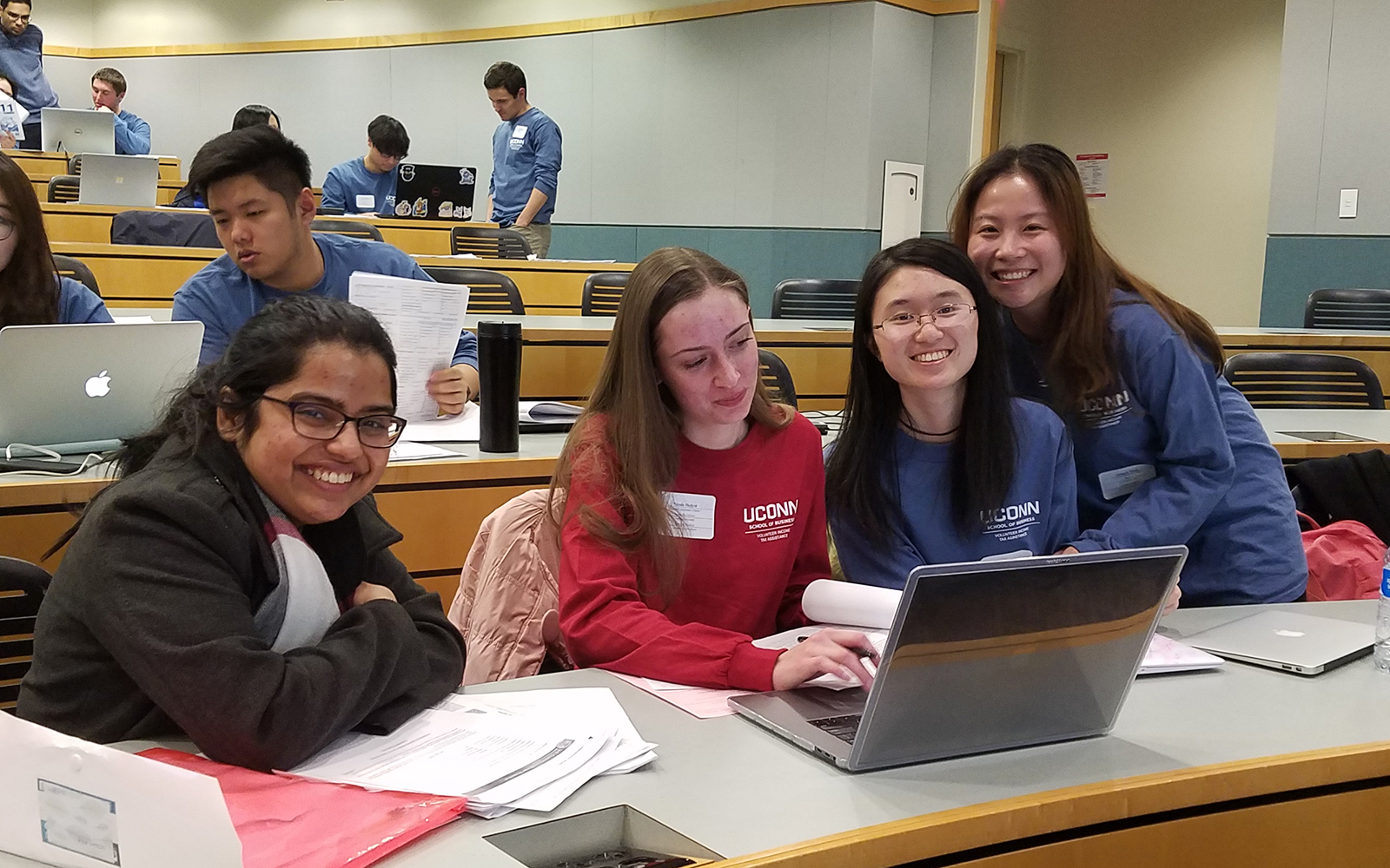 Volunteers prepared taxes for over 700 people this year in the VITA Program.  From left, graduate student Debadarshini Mishra, second-year reviewer Nicole Holyst and first-year preparers Jenny Wei and Qingya Yang.
